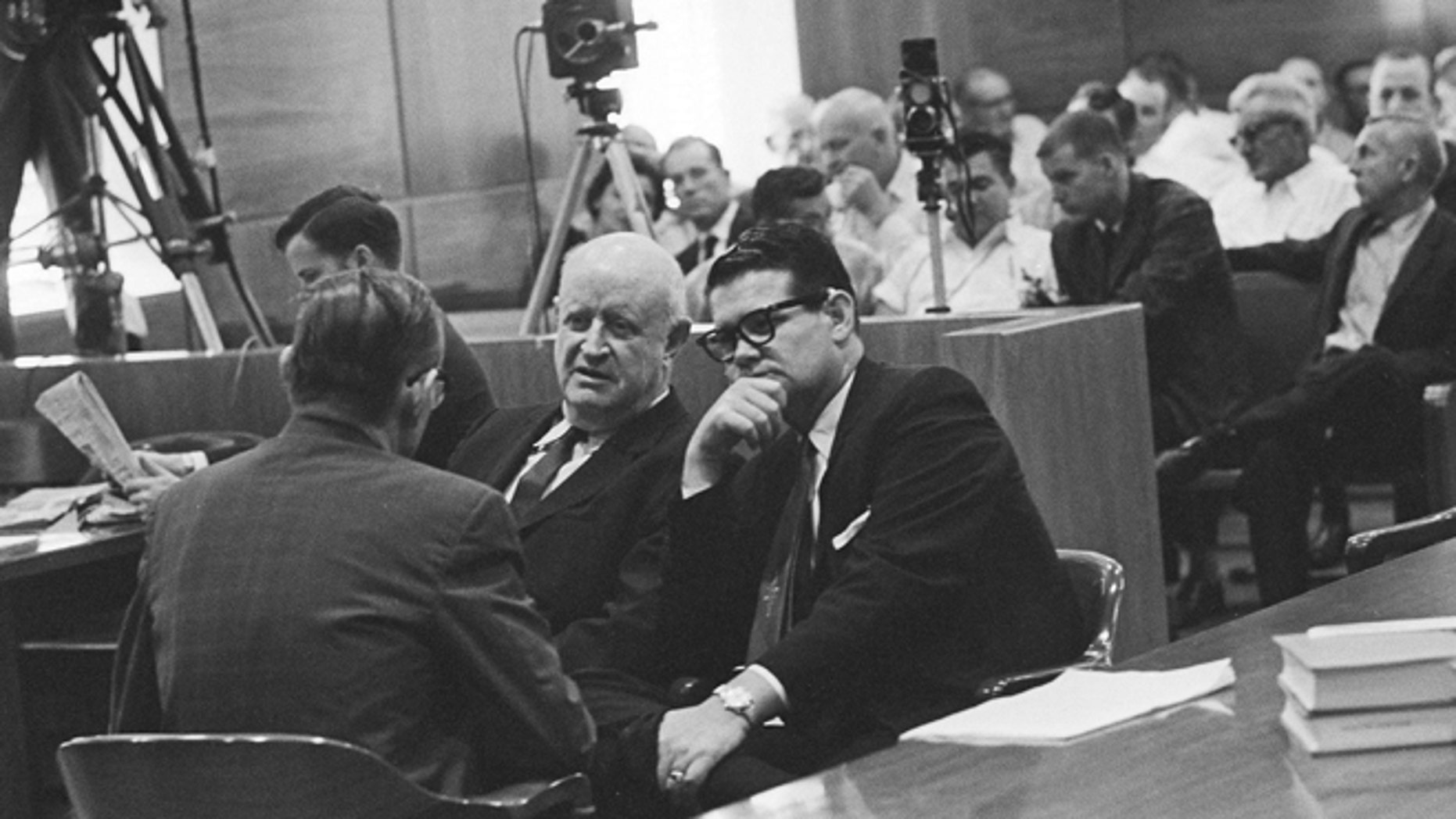 Sept. 25, 1962: In this file photo, Billie Sol Estes, right, confers with his attorneys, John Cofer, center, and John Dennison during recess in trial in Tyler, Texas