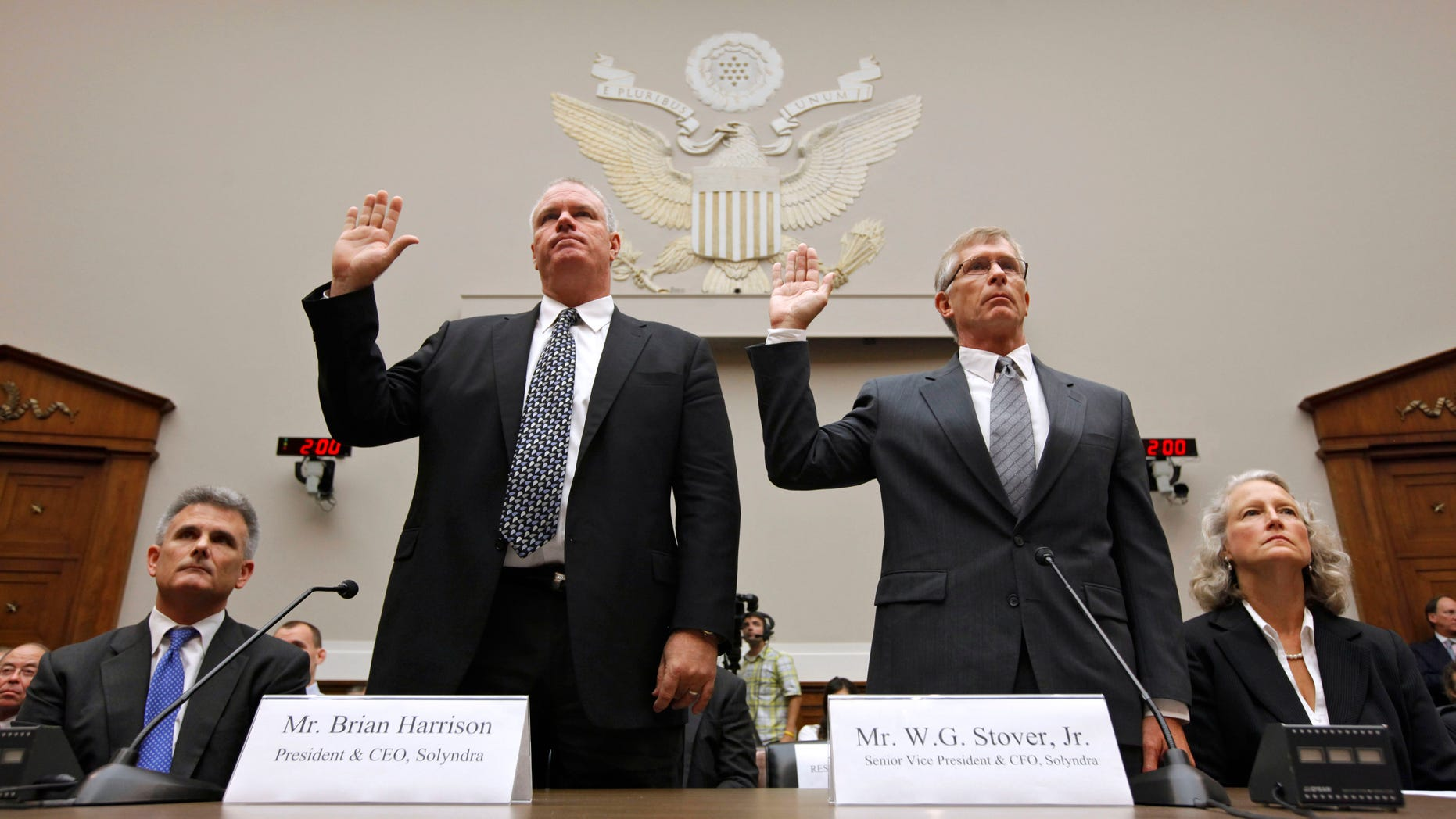 Solyndra CEO Brian Harrison. left, and Chief Financial Officer Bill Stover, right, are sworn in on Capitol Hill in Washington, Friday, Sept. 23 2011.