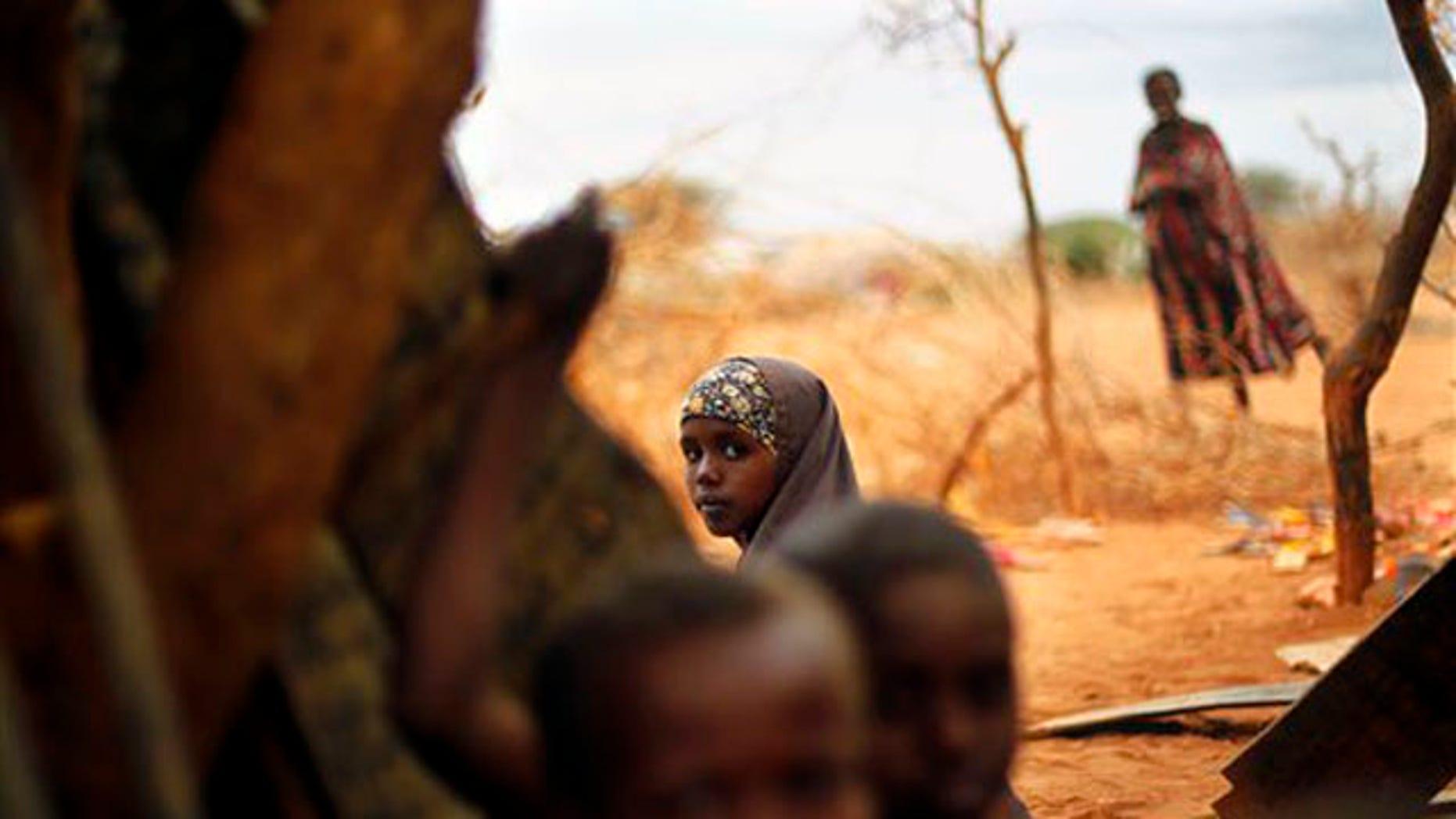 Tuesday: A Somali refugee sits at an outdoor madrasa at the Ifo camp outside Dadaab, Eastern Kenya.
