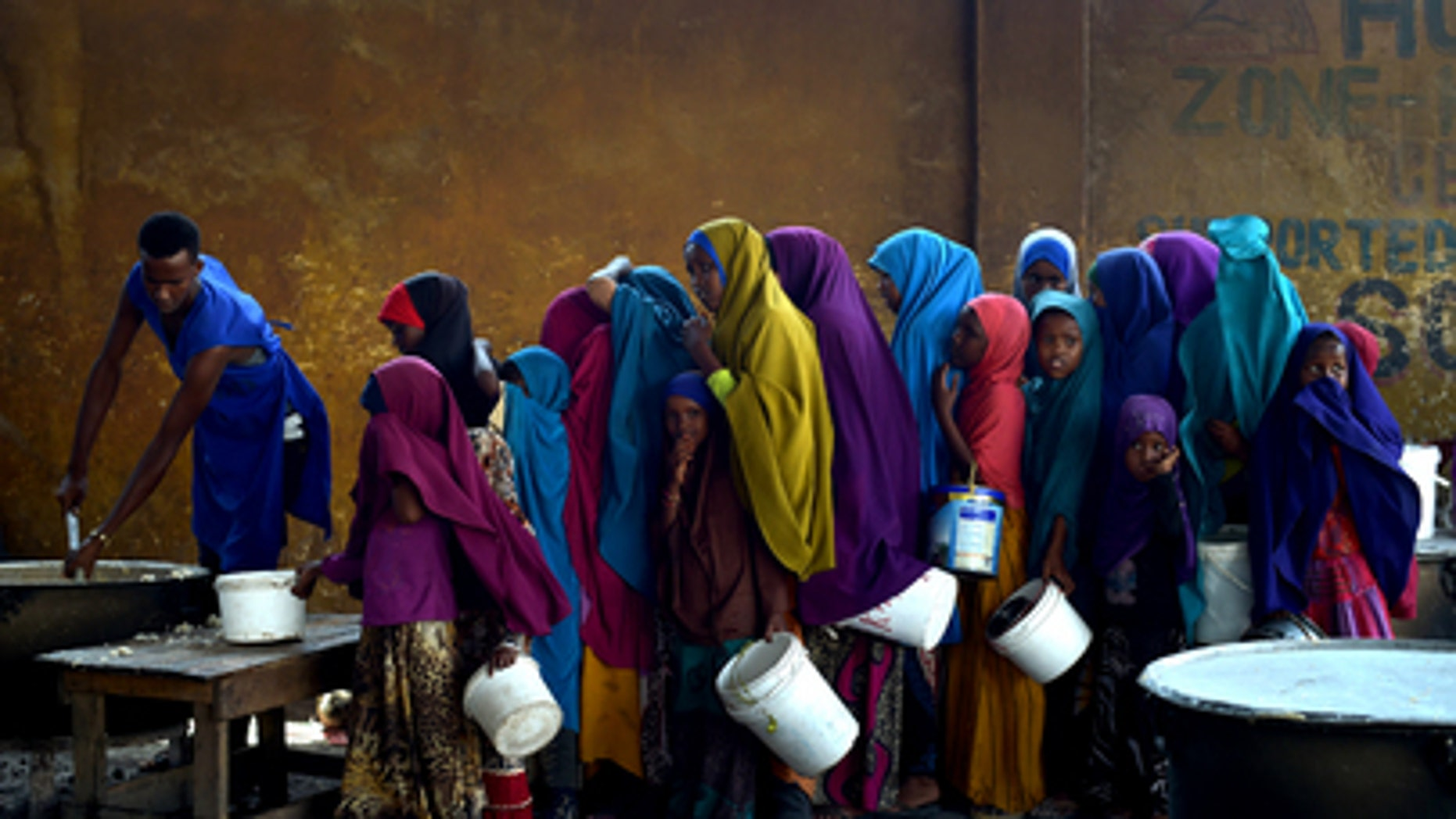 Somali girls line up in March 2017 at a feeding center in Mogadishu, where a severe drought could put 5.5 million people at risk for famine.