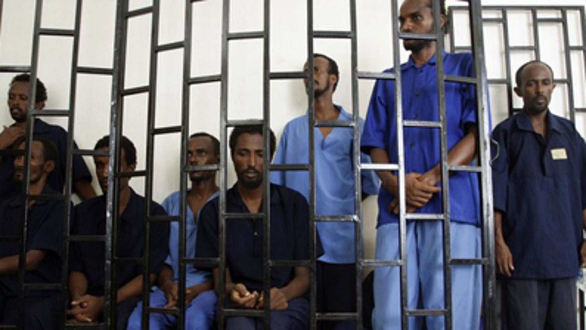 July 15, 2009: Suspected Somali pirates appear behind bars of a court in Yemen's southern port city of Aden. Worldwide piracy figures have reached a five-year low, according to the International Maritime Bureau. (Reuters)