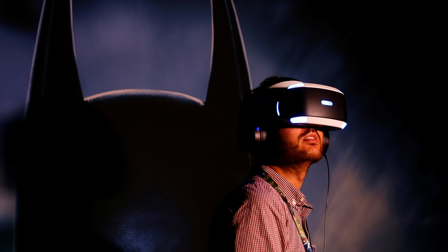 People try the new Sony VR headset during Sony Corporation's PlayStation 4 E3 2016 event in Los Angeles, California, U.S. June 13, 2016. (REUTERS/Mike Blake)
