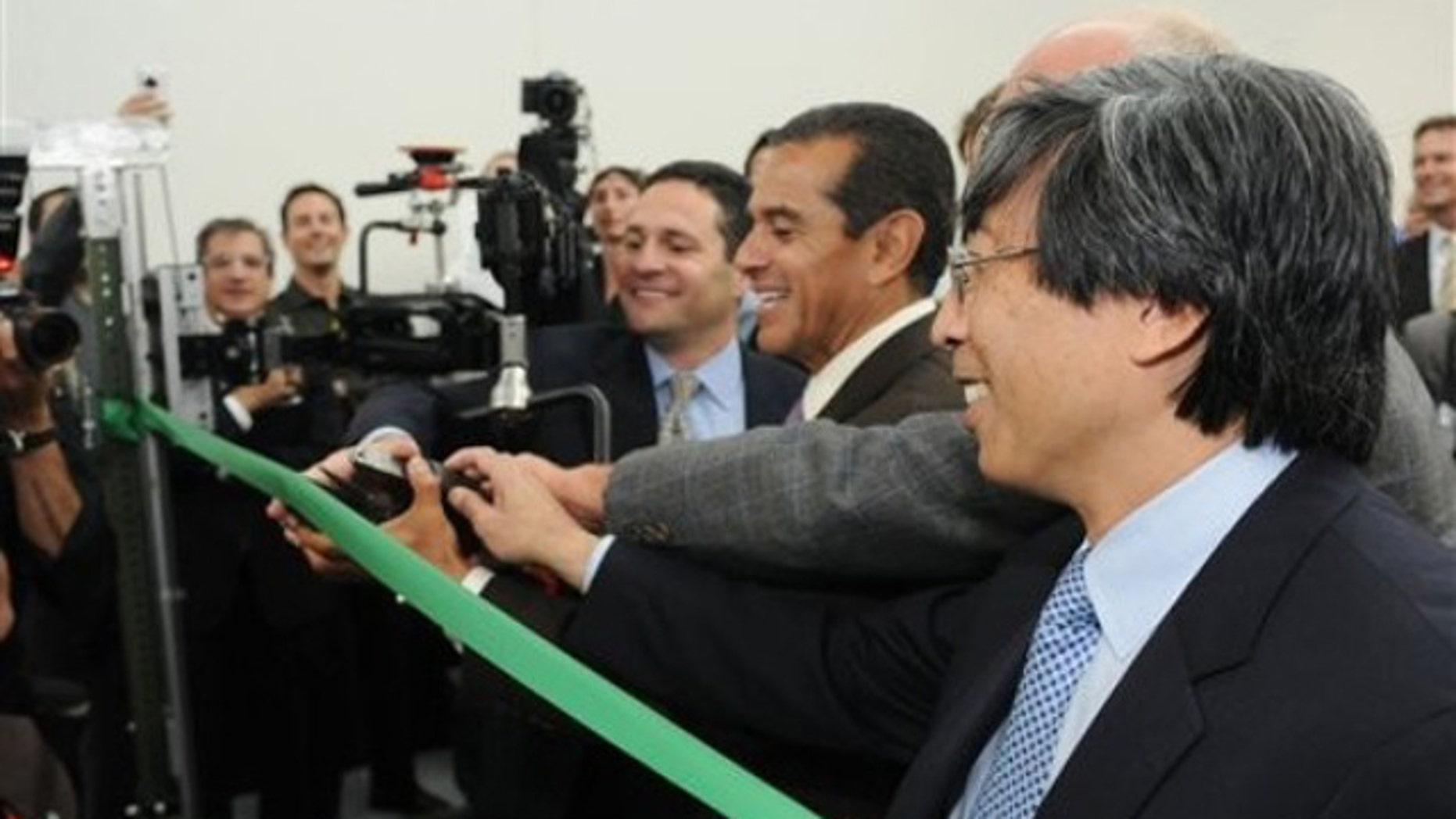 June 8, 2011: Dr. Patrick Soon-Shiong, right, is seen at an event for a new heavy aerospace cutting tool in Los Angeles.