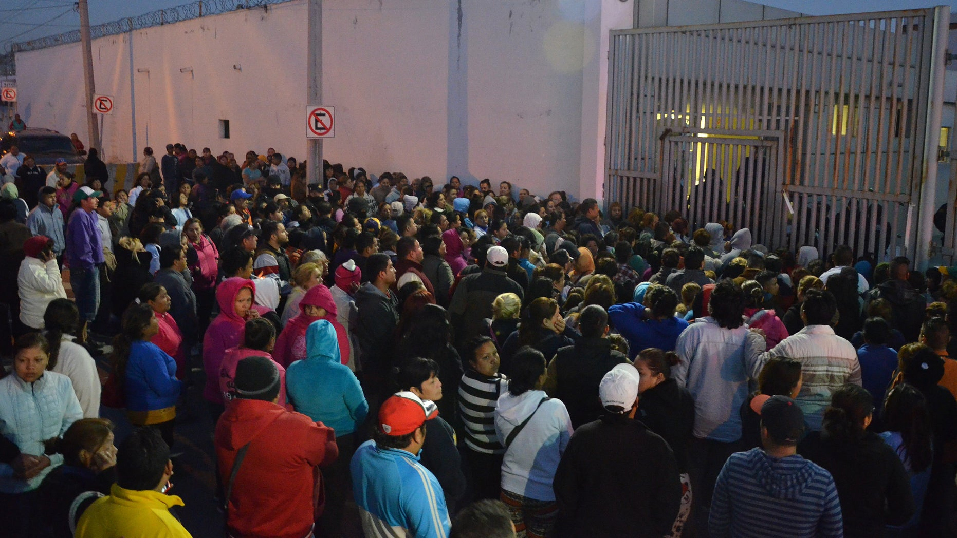 Feb. 11, 2016: Relatives of inmates stand outside the Topo Chico prison, where a riot broke out overnight in Monterrey, Mexico. (AP)