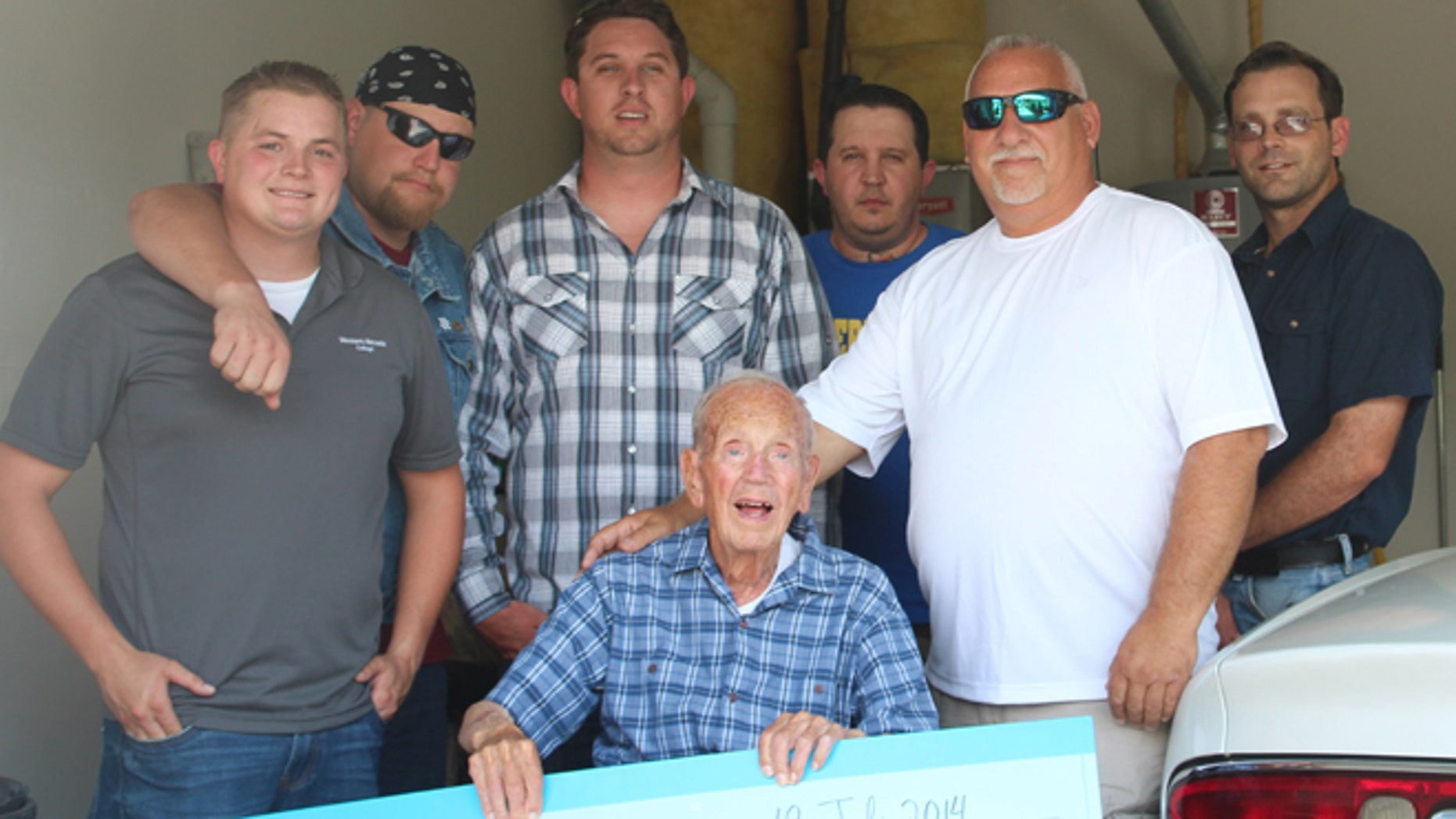 James V. Sorrentino, of Carson City, Nev., received the hefty lump sum in the form of an oversized check from members of Western Nevada College's Veterans Resource Center on Friday, nearly two months after two men forced their way into his home looking for a safe on May 25. (Courtesy: Western Nevada College Veterans Resource Center)