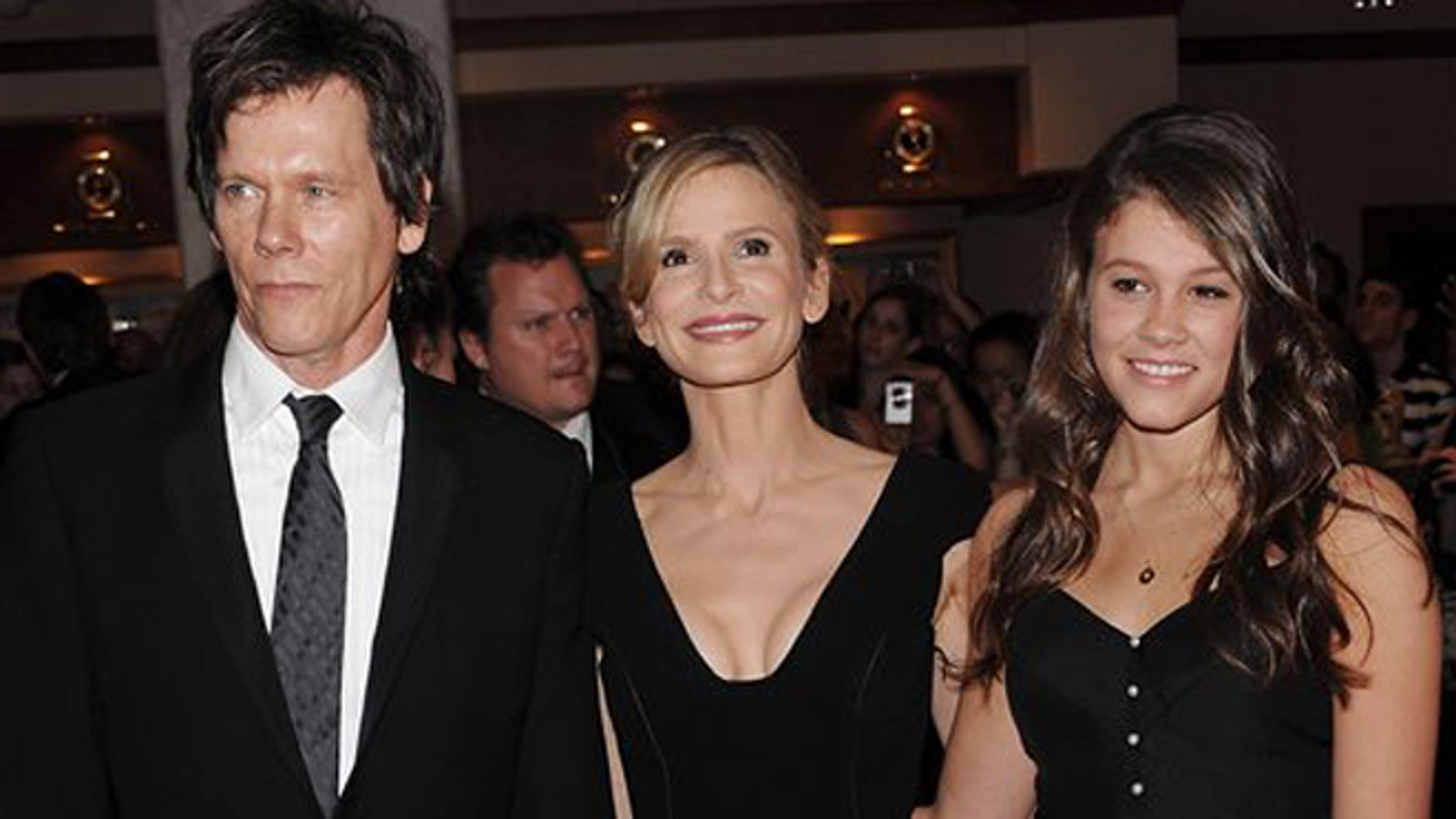 FILE - In this May 9, 2009 file photo, actors Kevin Bacon, left, and Kyra Sedgwick, center, pose with their daughter Sosie Bacon at the 2009 White House Correspondents' Association Dinner at the Washington Hilton, in Washington. The Hollywood Foreign Press Association has selected the actress Sosie Bacon as Miss Golden Globe 2014 for the 71st Annual Golden Globe Awards.  It was announced by the HFPA Thursday, Nov. 21, 2013, at an event held at Fig and Olive in West Hollywood, Calif. (AP Photo/Evan Agostini)