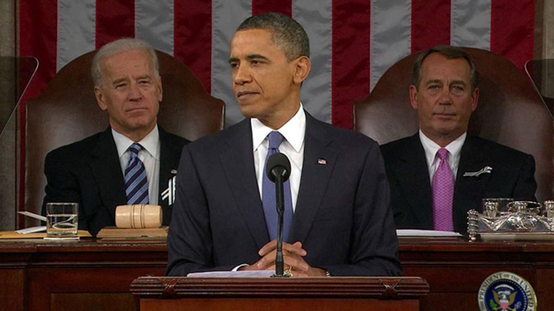 Jan. 25: President Obama addresses Congress during his State of the Union Address as Vice President Joe Biden and House Speaker John Boehner listen.