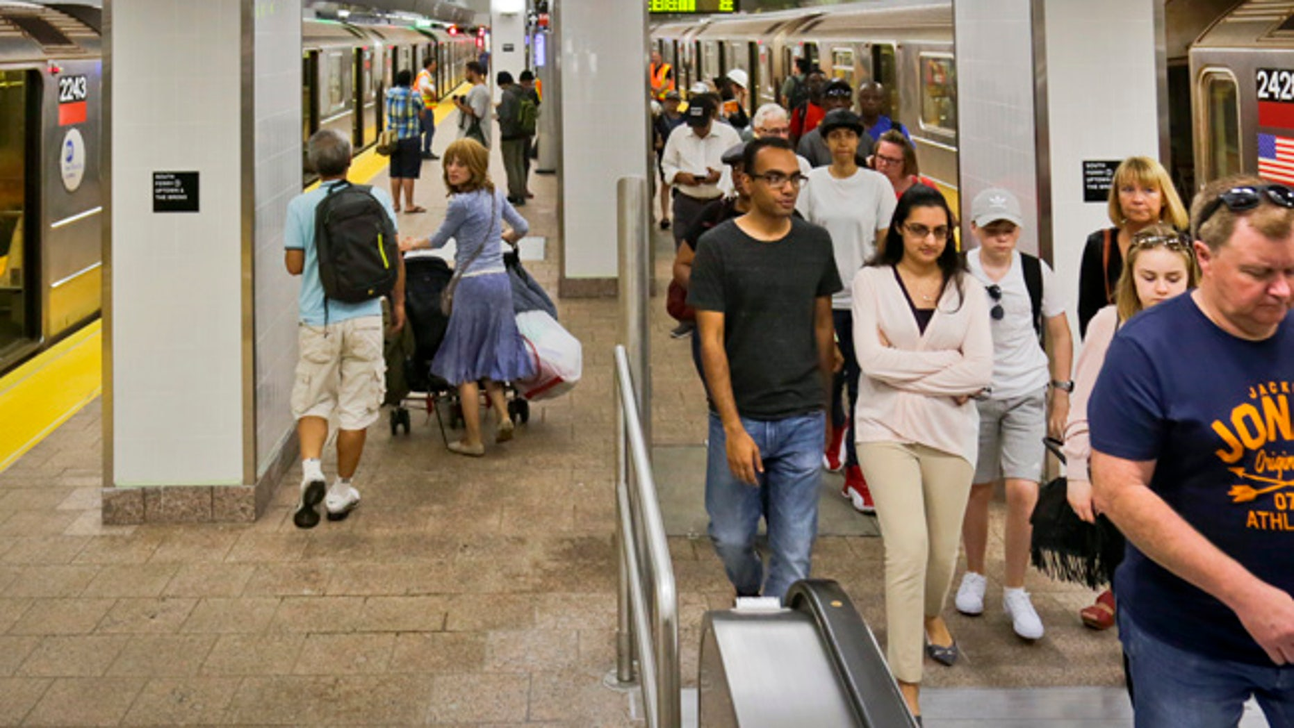 Passengers leave the No. 1 train at the South Ferry Station, Tuesday June 27, 2017, in New York. The station reopened Tuesday, nearly five years after it was flooded by Superstorm Sandy in October 2012.  (AP Photo/Bebeto Matthews)