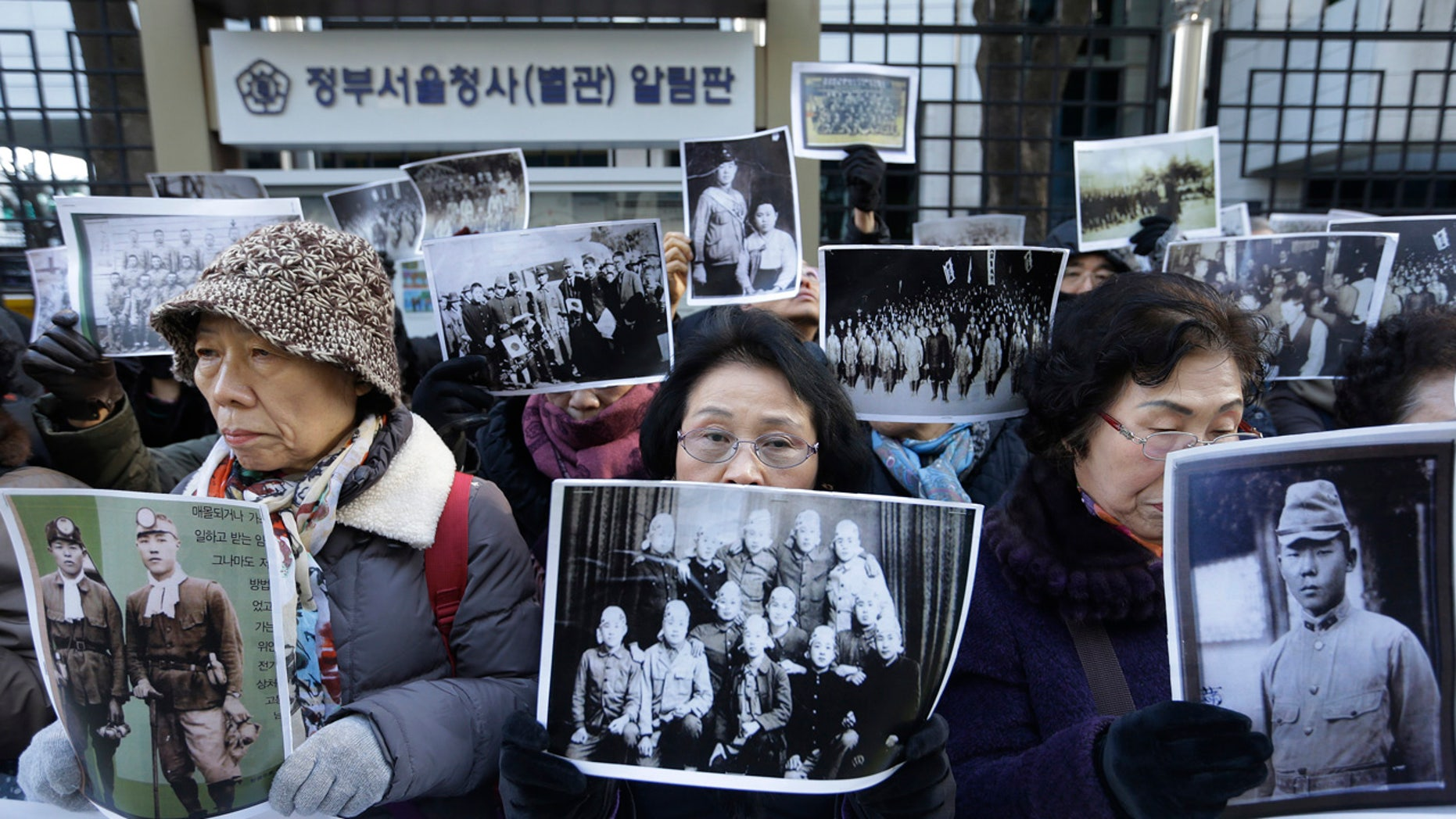 Dec. 28, 2015: Bereaved family members of South Korean victims of World War II stage a rally in front of the Foreign Ministry in Seoul demanding full compensation and an apology from the Japanese government (AP Photo/Ahn Young-joon)