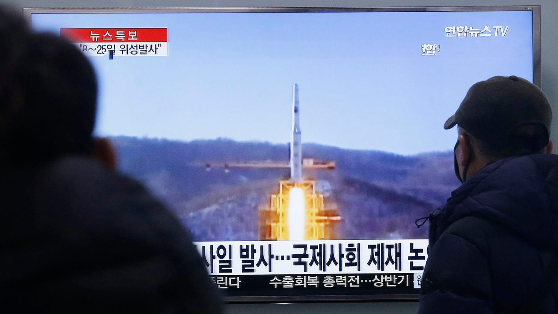 Feb. 3, 2016: South Koreans watch a TV news program with a file footage about North Korea's rocket launch plans at Seoul Railway Station. (AP Photo/Ahn Young-joon)