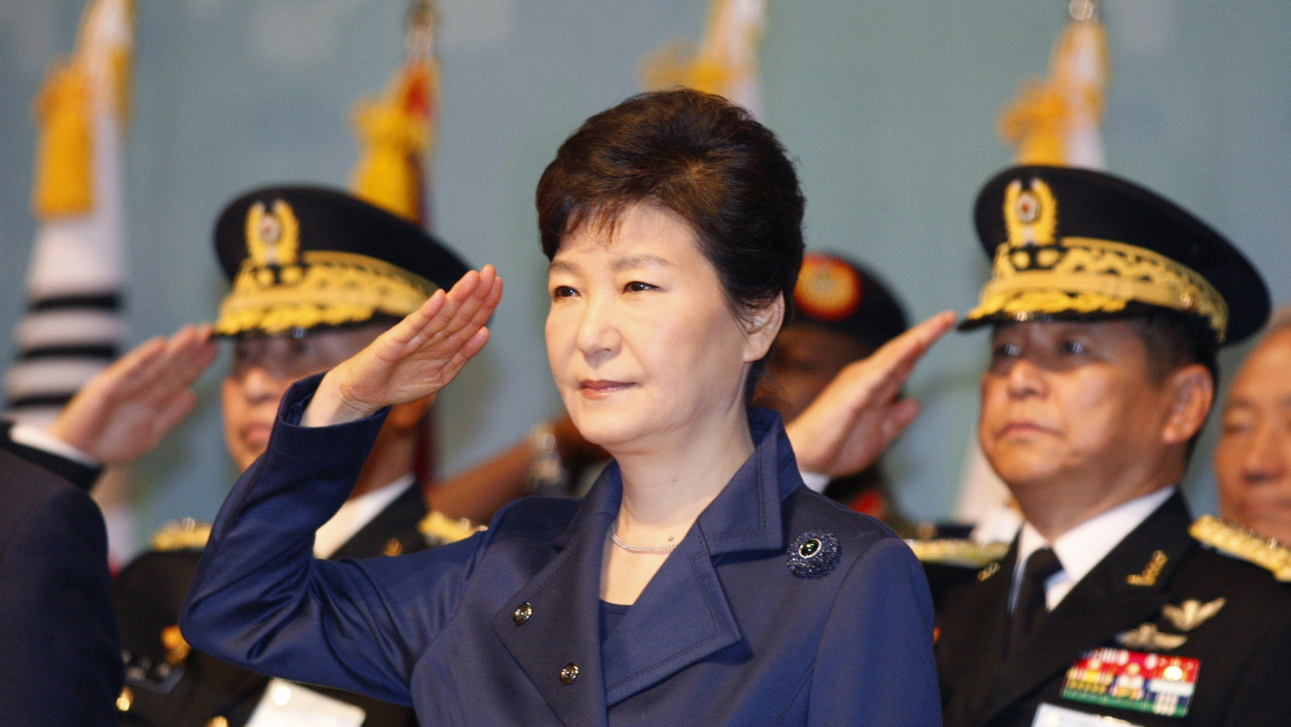 South Korean President Park Geun-hye, center, gives a salute during the 67th Armed Forces Day at Gyeryongdae, South Korea's main compound in Gyeryong City, South Korea, Oct. 1, 2015. (Kim Hee-chul/Pool Photo via AP)