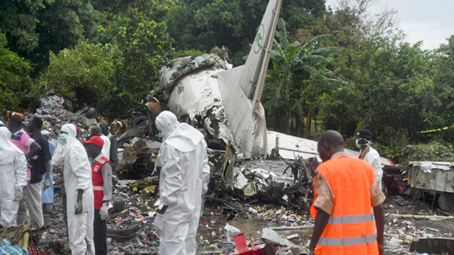 Nov. 4, 2015: Responders pick through the wreckage of a cargo plane which crashed in the capital Juba, South Sudan.  The cargo plane was taking off from the South Sudanese capital of Juba when it crashed along the banks of the Nile River, killing dozens according to witnesses and the government.