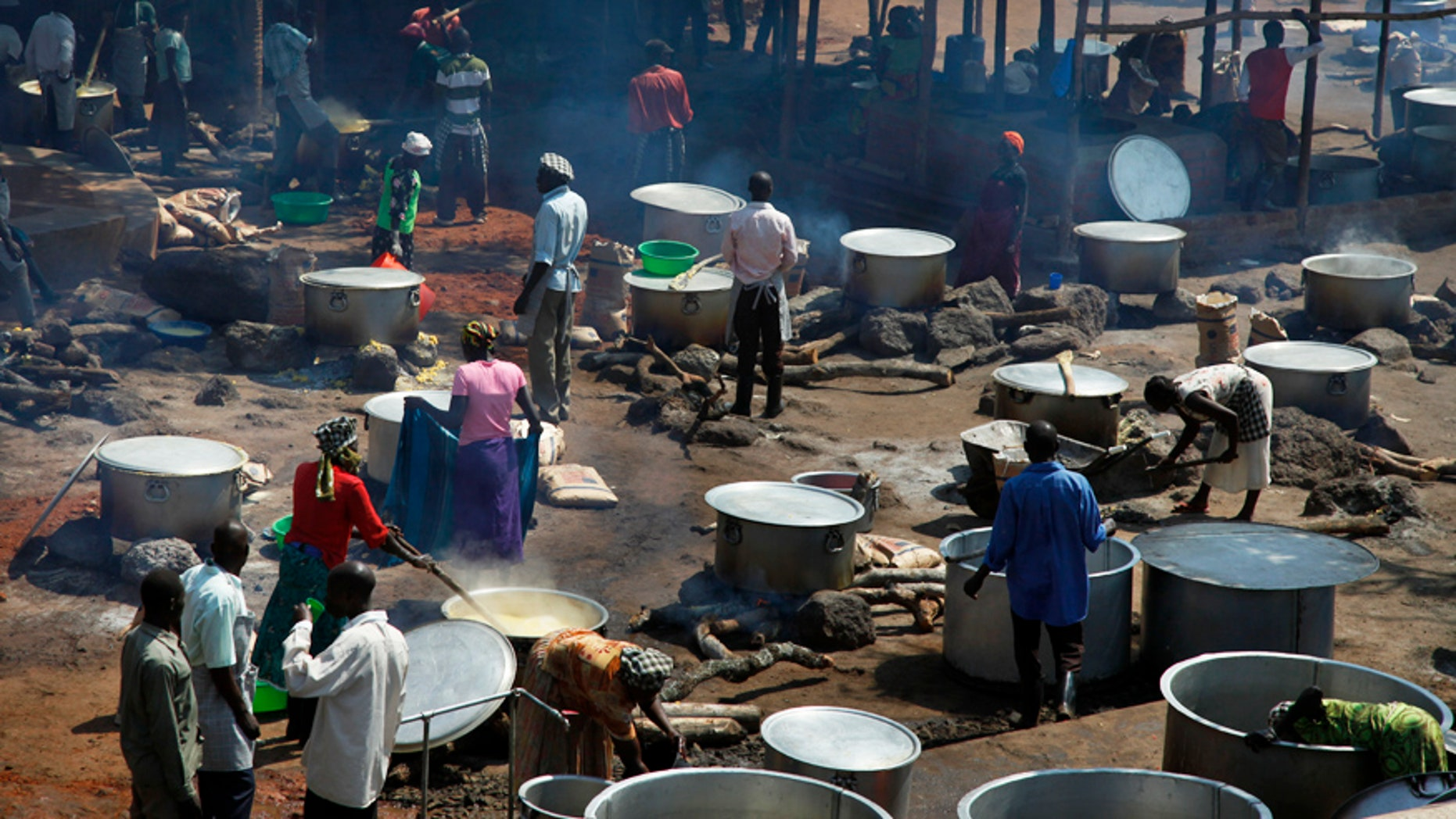 Aug. 29, 2016: Refugees prepare food in a transit center for South Sudanese refugees in the remote northwestern district of Adjumani, near the border with South Sudan, in Uganda.