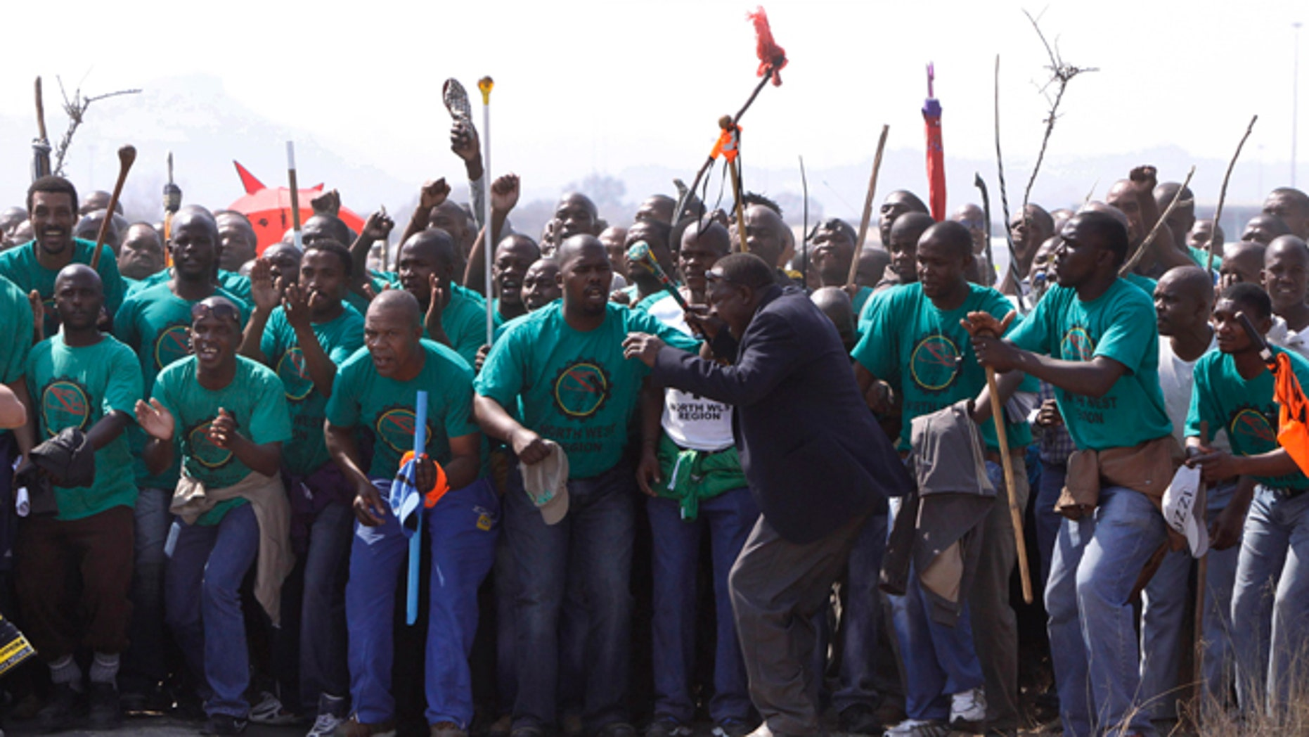 August 23, 2012: Mourners make their way to a memorial service at the Lonmin Platinum Mine near Rustenburg, South Africa after police shot and killed 34 striking miners and wounded 78 last week.