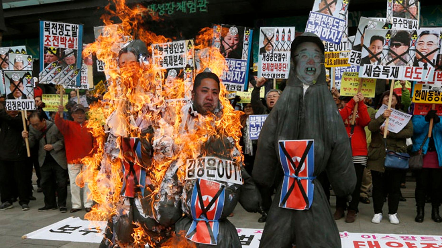 April 15, 2013: South Korean protesters burn effigies of North Korean leader Kim Jong Un, and late leaders Kim Jong Il and Kim Il Sung at an anti-North Korea protest on the birthday of Kim Il Sung in Seoul, South Korea.