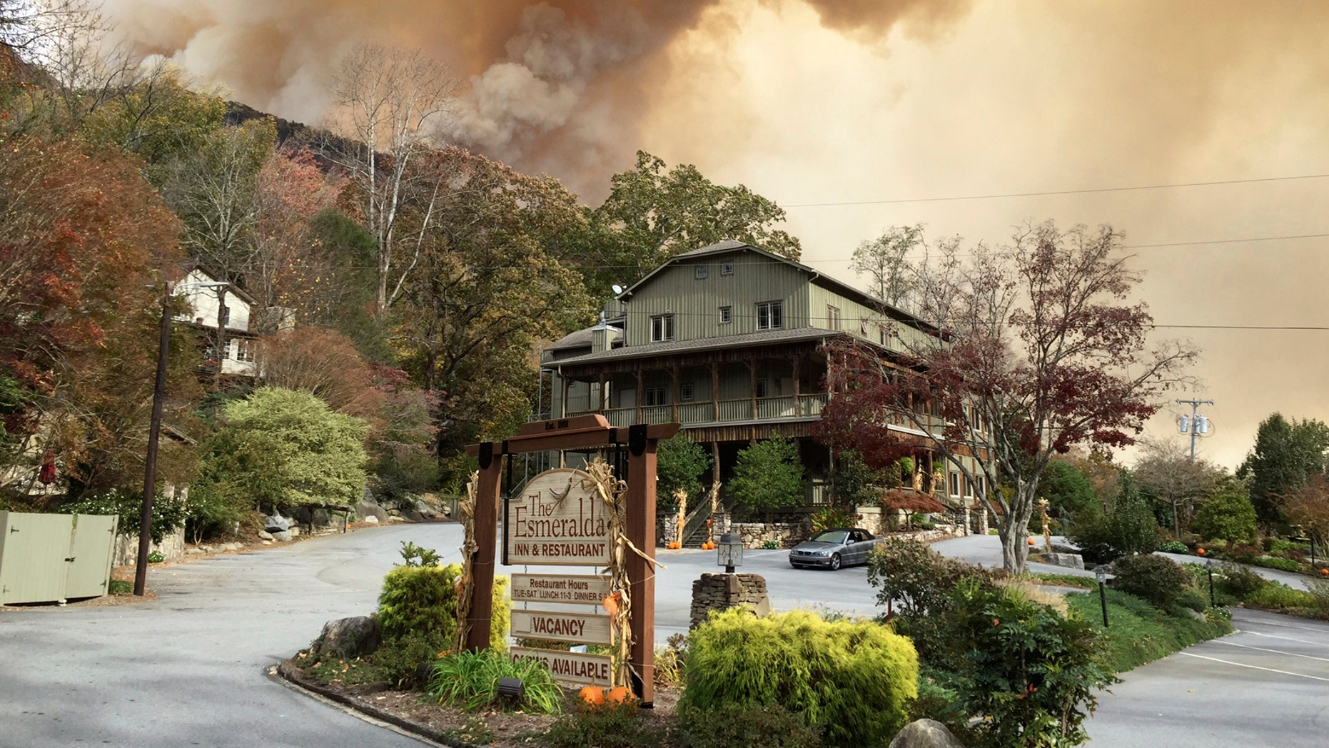 This photo made available by Don Cason shows his business, The Esmeralda Inn and Restaurant, which was evacuated due to the proximity of wildfires, Friday, Nov. 11, 2016 in Lake Lure, N.C. Cason had his 125-year-old inn in the western North Carolina mountains booked solid, rooms full and restaurant reservations lined up, for Veterans Day weekend.  (Don Cason via AP)
