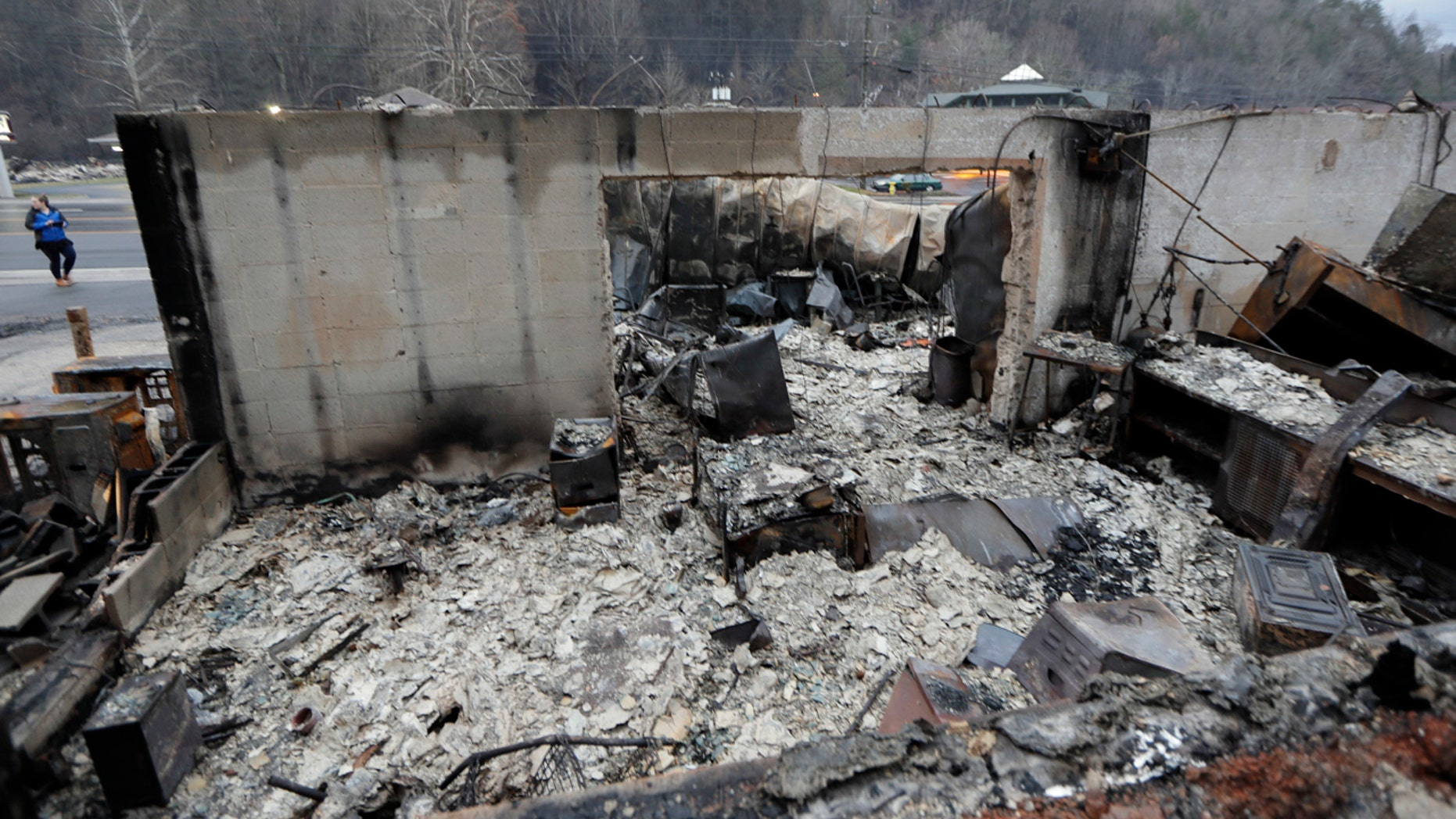 Some walls of a burned-out business remain Wednesday, Nov. 30, 2016, in Gatlinburg, Tenn., after a wildfire swept through the area Monday.