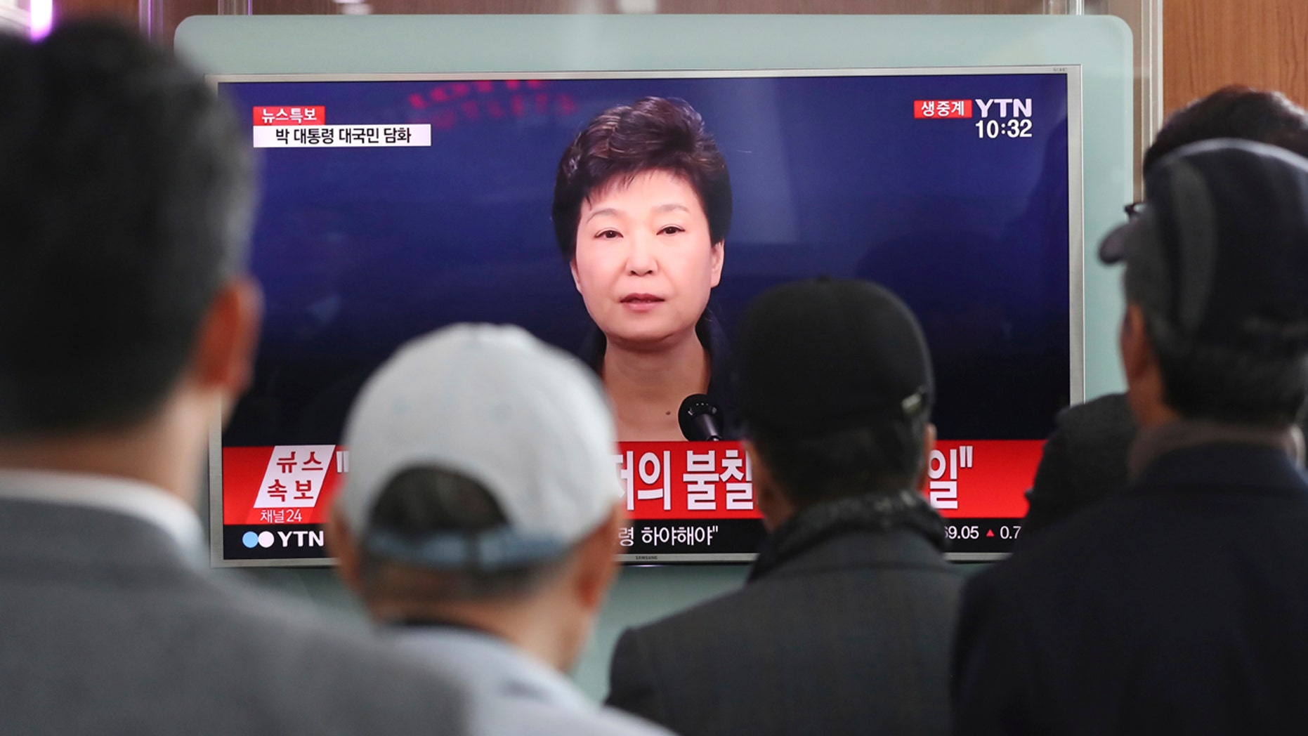 Nov. 4, 2016: People watch a TV screen showing the live broadcast of South Korean President Park Geun-hye's address to the nation, at the Seoul Railway Station in Seoul, South Korea.