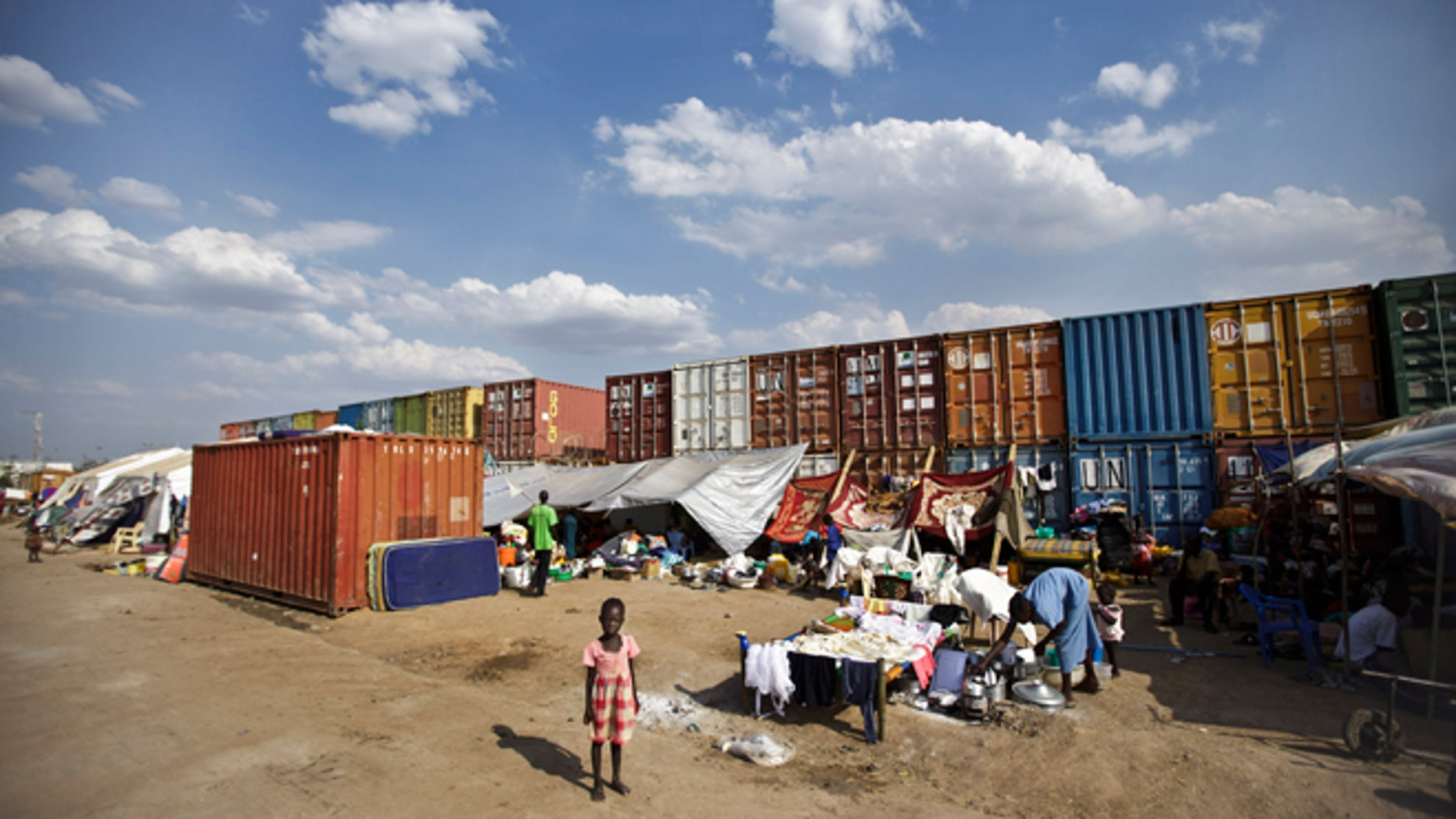 Dec. 29, 2013: In this file photo, a displaced child stands in front of the makeshift tents where she and others live next to shipping containers at a United Nations compound which has become home to thousands of people displaced by the recent fighting, in the capital Juba, South Sudan.