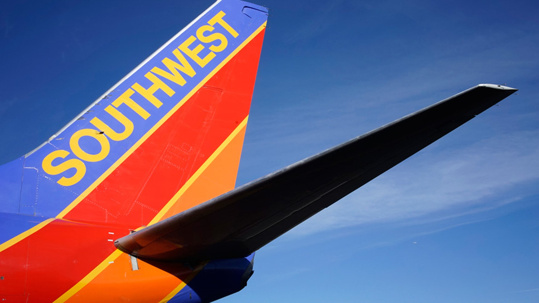 A Southwest pilot showered his millionth customer with Champagne and cash.
