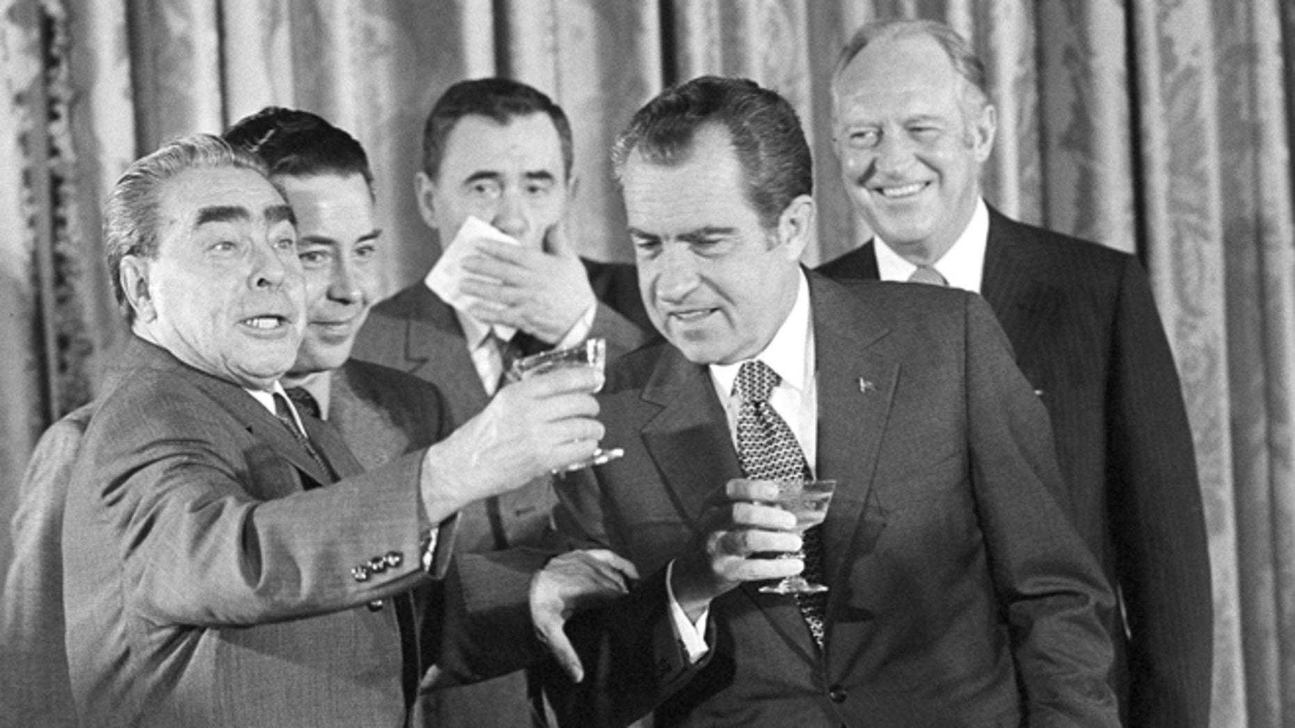 In this June 19, 1973 file photo, Soviet party chief Leonid I. Brezhnev, left, proposes a toast at the State Department in Washington after signing of the U.S.-Soviet cooperative agreements. Others from left, interpreter Viktor Sukhodrev, Russian Foreign Minister Andrei Gromyko, President Nixon and Secretary of State William F. Rogers. Viktor Sukhodrev, the Soviet interpreter who for three decades brought the words of Kremlin leaders to the English-speaking world died in Moscow on Friday May 16, 2014 at the age of 81.