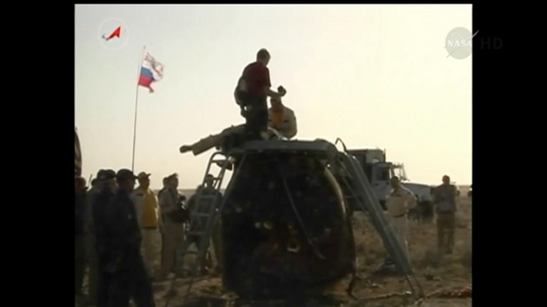 A Russian Soyuz capsule carrying three astronauts rests on the ground after landing in Kazakhstan on May 13, 2014.