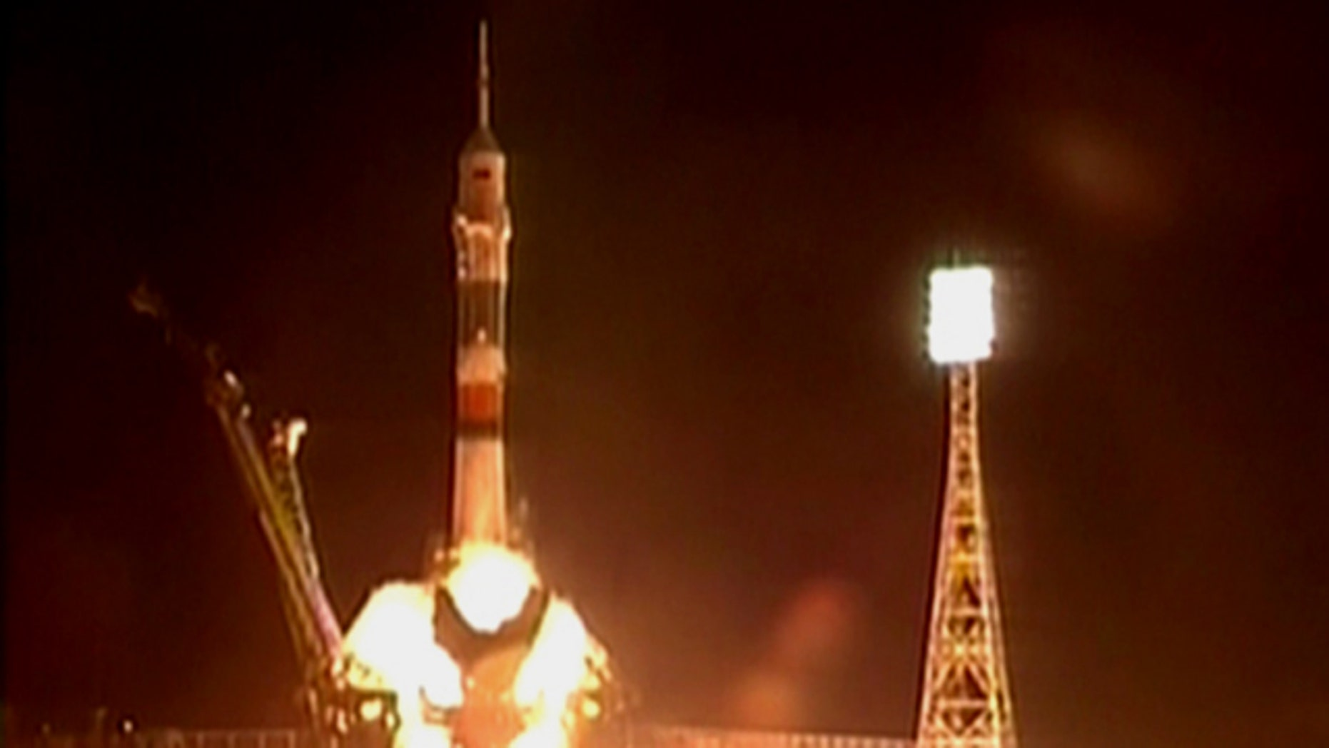 The new Soyuz TMA-01M blasts off with a crew of three astronauts from the Baikonur Cosmodrome in Kazakhstan at 7:10 p.m. EDT (2310 GMT) on Oct. 7, 2010.