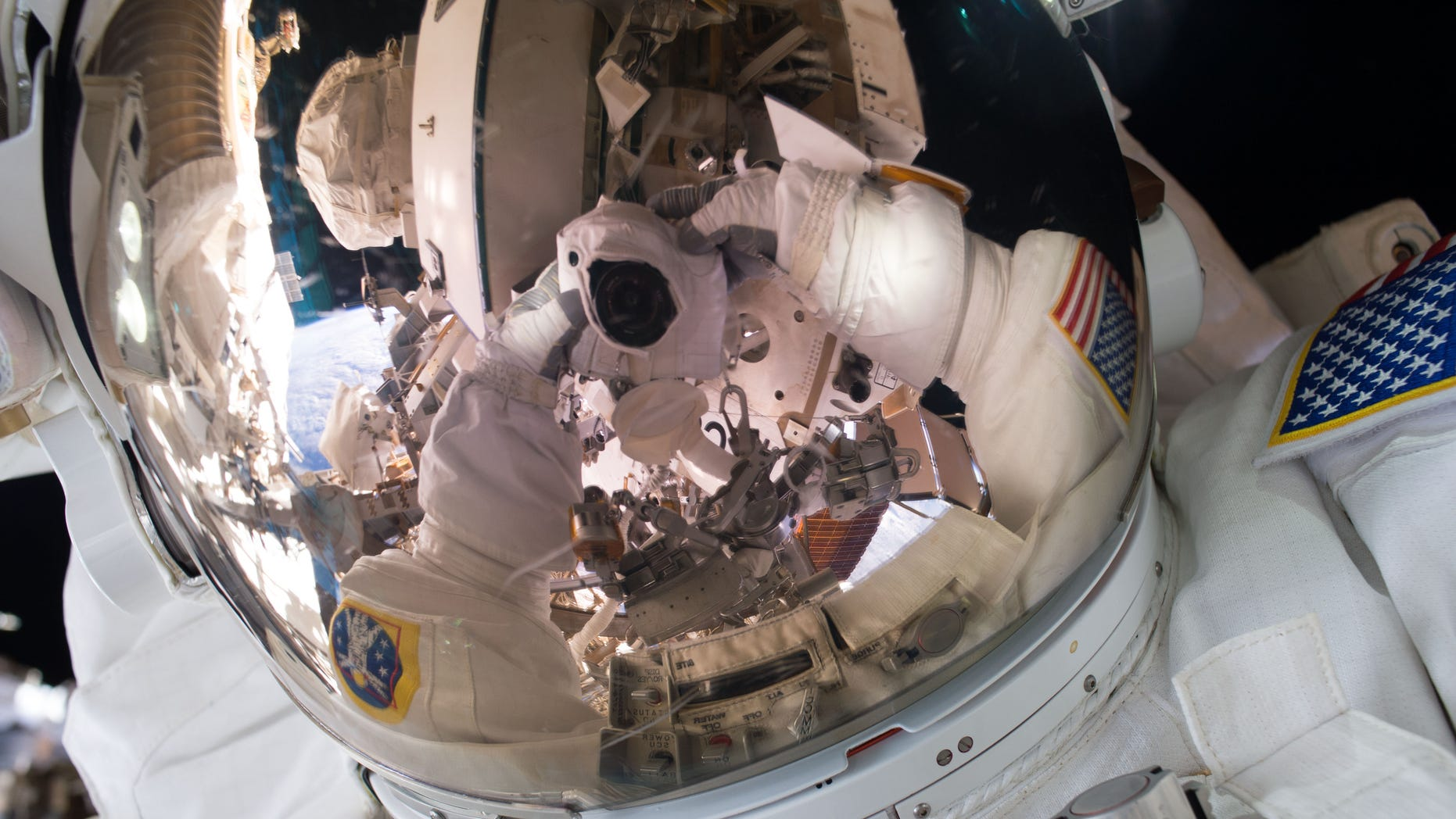 (NASA –Astronaut Scott Kelly takes a selfie during a spacewalk on October 28, 2015)