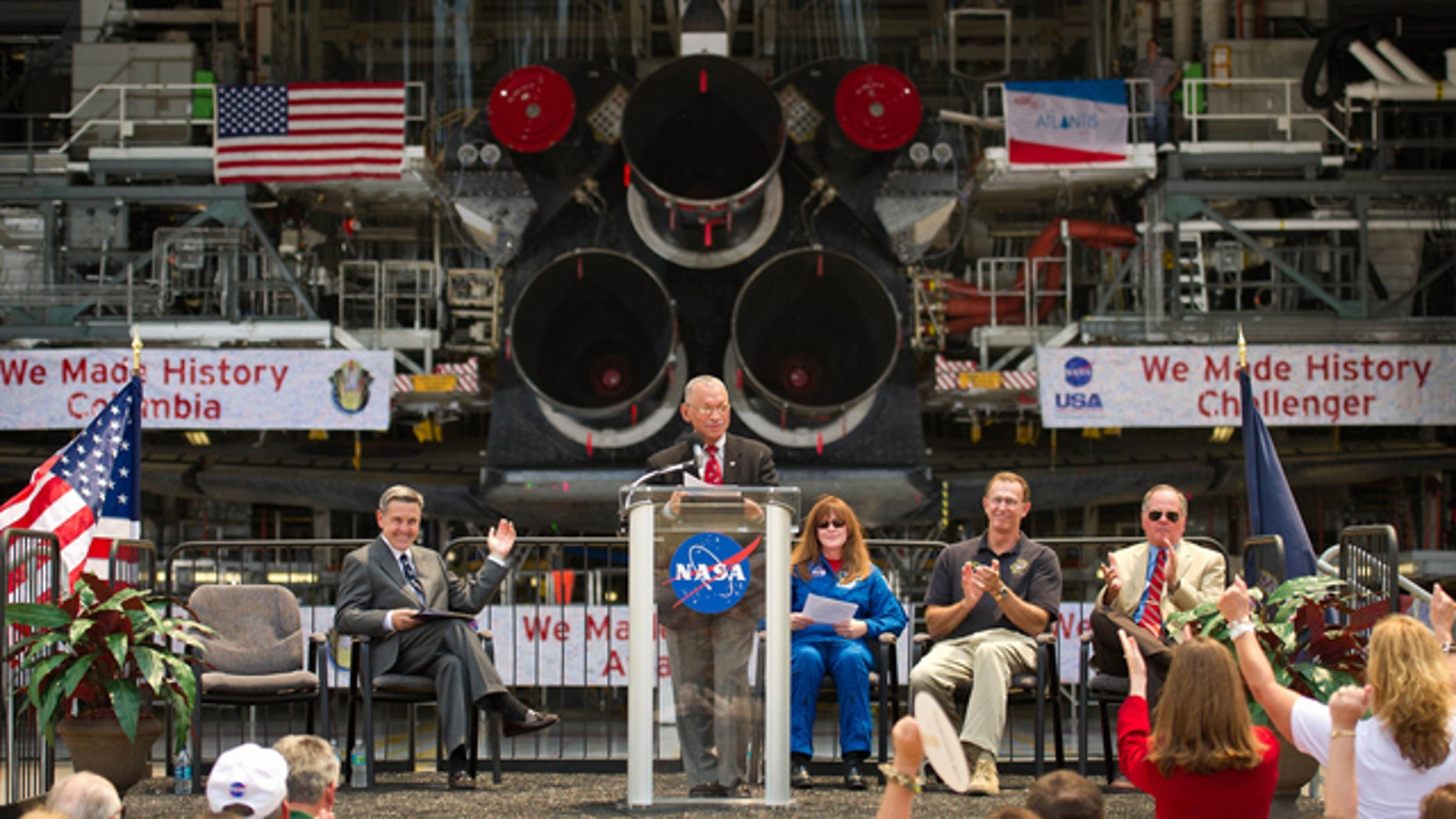 NASA Administrator Charles Bolden announces where four space shuttle orbiters will be permanently displayed at the conclusion of the Space Shuttle Program during an event held at one of the Orbiter Processing Facilities, Tuesday, April 12, 2011, at Kennedy Space Center in Cape Canaveral, Fla. The four orbiters, Enterprise, which currently is on display at the Smithsonian's Steven F. Udvar-Hazy Center near Washington Dulles International Airport, will move to the Intrepid Sea, Air & Space Museum in New York, Discovery will move to Udvar-Hazy, Endeavour will be displayed at the California Science Center in Los Angeles and Atlantis, in background, will be displayed at the Kennedy Space Center Visitors Complex.  Photo Credit: (NASA/Bill Ingalls)