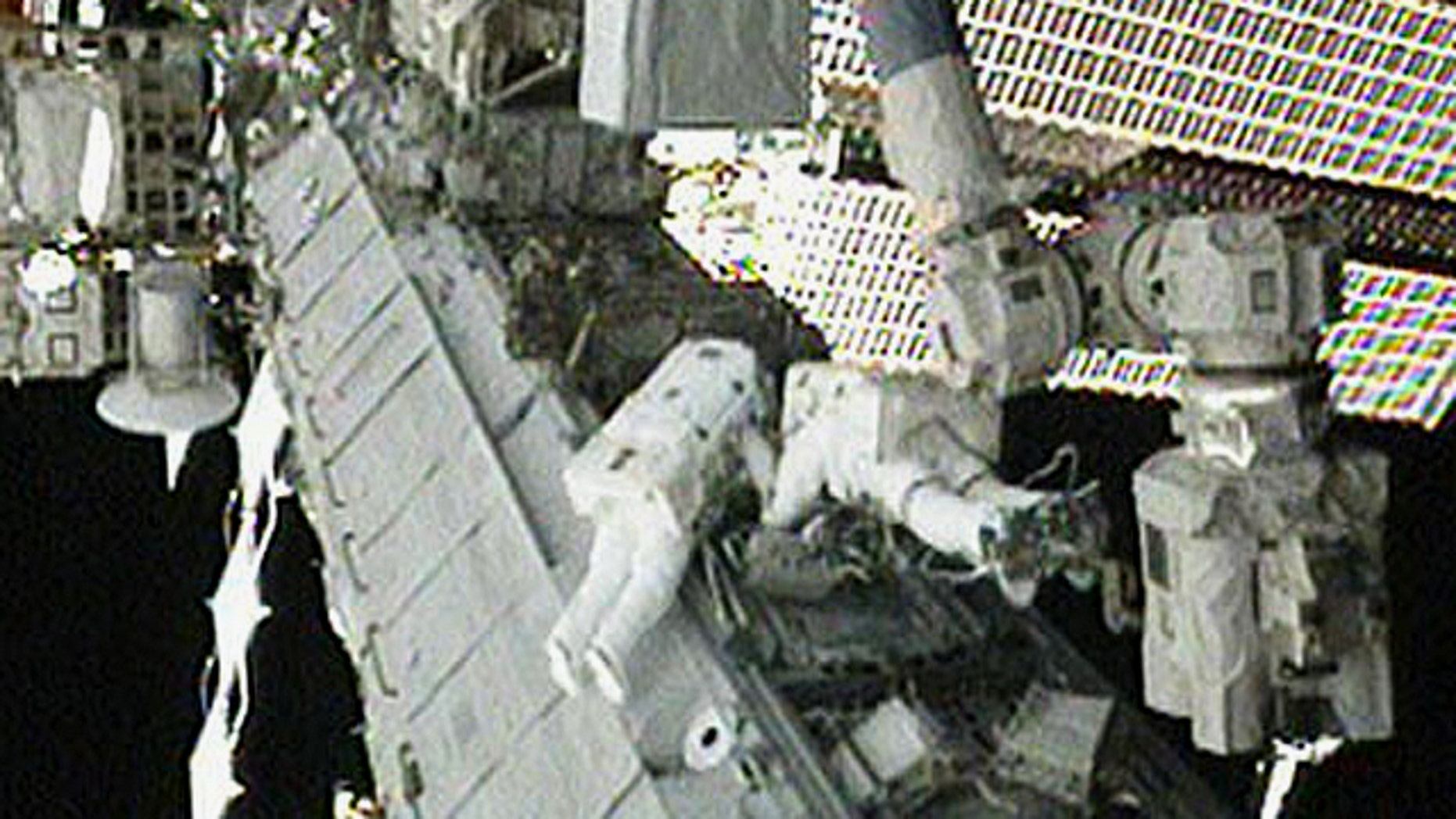 NASA astronauts Tracy Caldwell Dyson (left) and Doug Wheelock work to set up the ammonia spare pump module after it was installed on the S1 Truss during an Aug. 16, 2010 spacewalk outside the International Space Station. It was the third spacewalk dedicated to the repair.