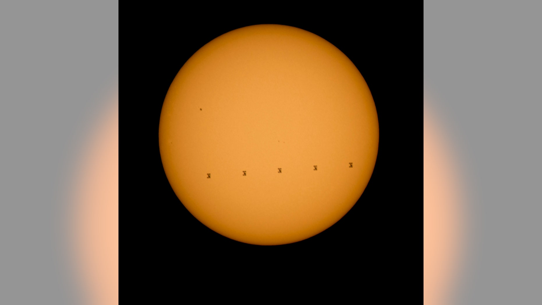 This composite photo made from five images shows the International Space Station crossing the sun's face on Sept. 6, 2015. The images were captured from Shenandoah National Park in Virginia.