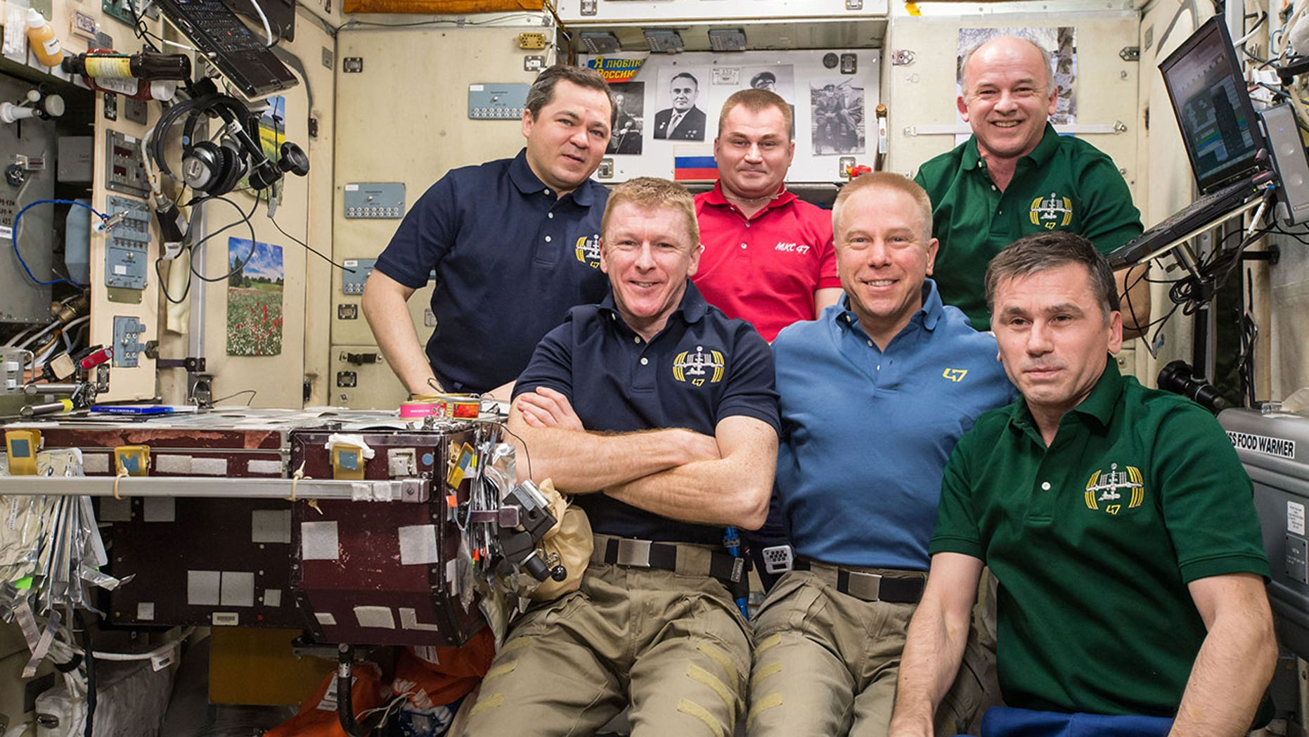 The Expedition 47 crew poses for the three millionth image taken aboard the International Space Station on April 30, 2016.