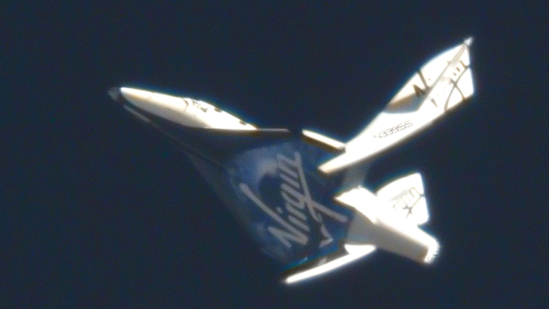May 4, 2011: Virgin Galactic's suborbital passenger ship SpaceShipTwo flexes its feathered re-entry system during a pivotal glide test at the Mojave Air and Space Port in California.