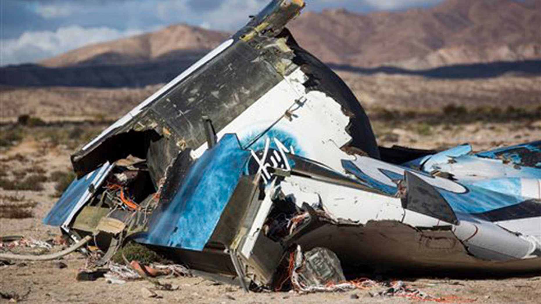 Nov. 1, 2014: In this file photo, wreckage lies near the site where a Virgin Galactic space tourism rocket, SpaceShipTwo, exploded and crashed in Mojave, Calif.