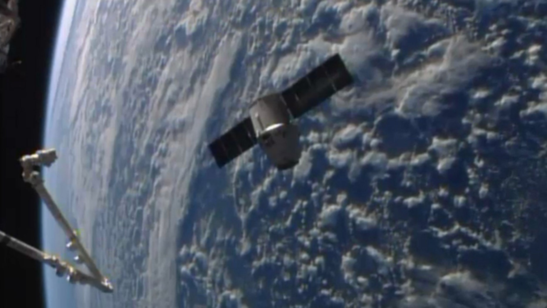 April 20, 2014: This frame grabbed image from NASA-TV shows the SpaceX Dragon resupply capsule approaching the International Space Station.