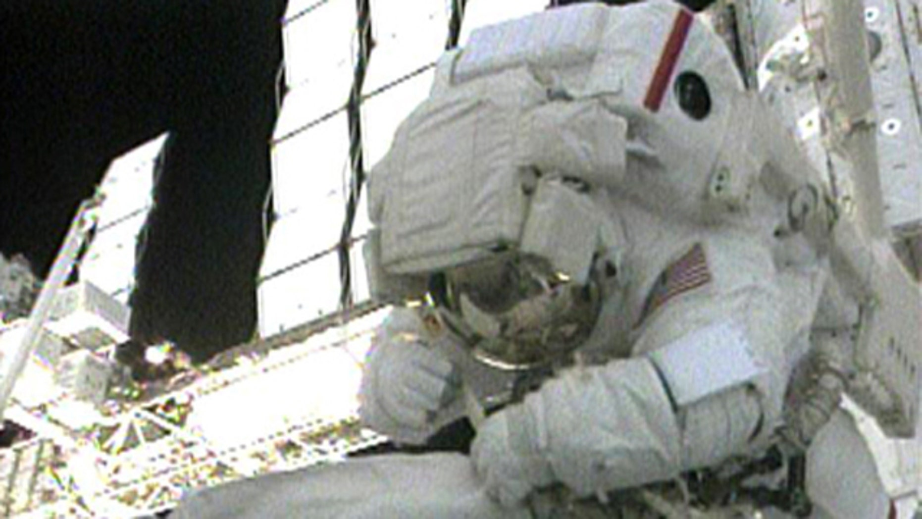 STS-130 Mission Specialist Bob Behnken works outside the International Space Station during the first spacewalk of the STS-130 mission on Feb. 10, 2010.