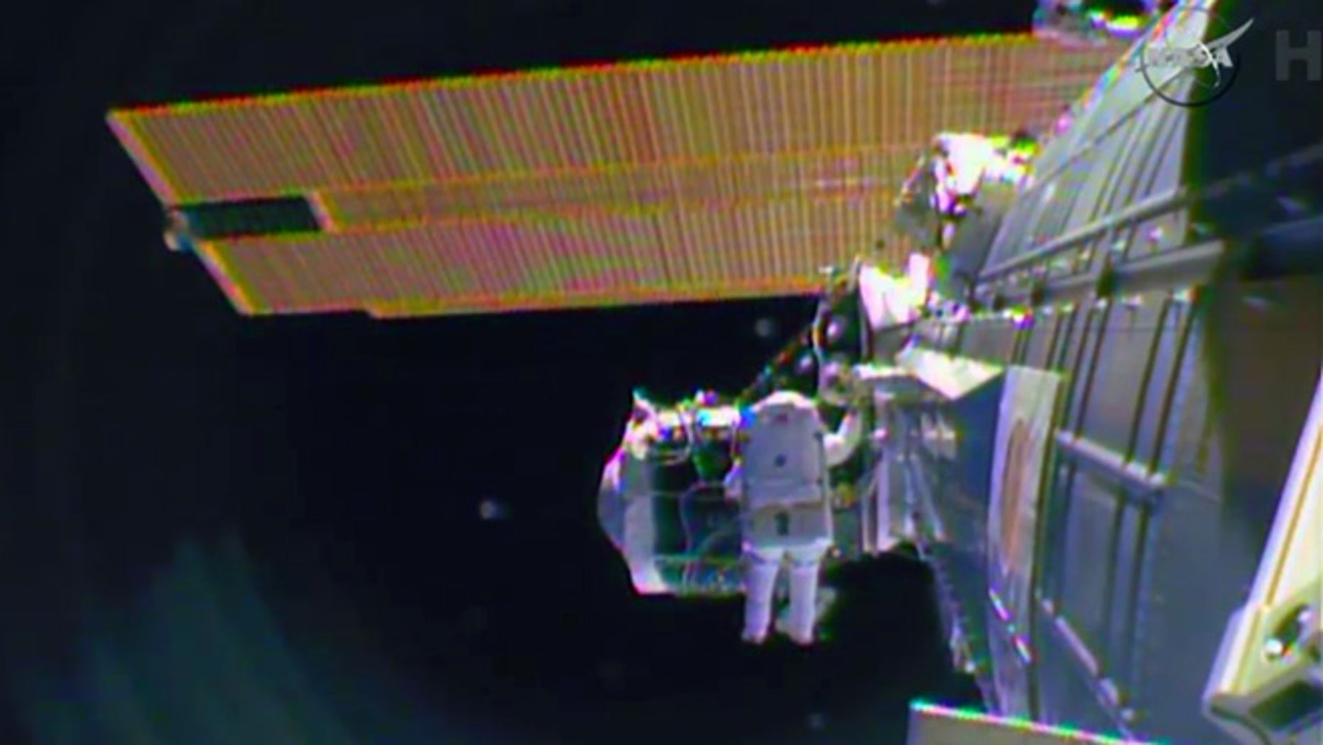 """Feb. 21, 2015: In this image from television astronaut Barry """"Butch"""" Wilmore begins the spacewalk to wire the International Space Station in preparation for the arrival in July of the international docking port for the Boeing and Space-X commercial crew vehicles.(AP)"""