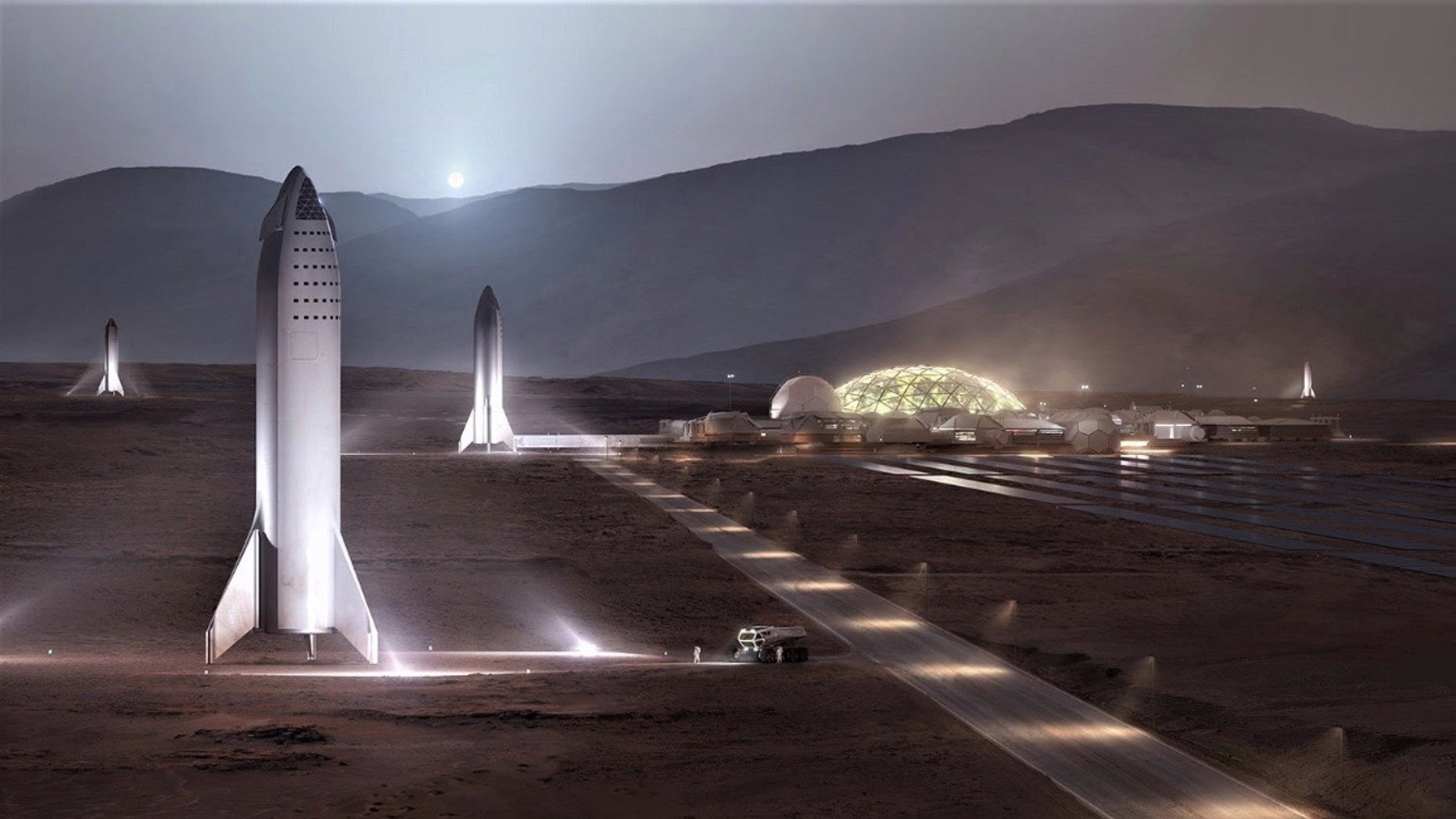 """An artist's illustration showing SpaceX BFR spaceships standing at the Red Planet outpost """"Mars Base Alpha."""""""