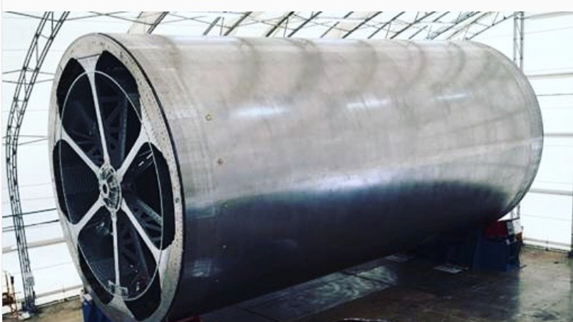 "SpaceX founder and CEO Elon Musk posted this photo on Instagram on April 8, 2018. It shows ""the main body tool"" for the company's Mars-colonizing BFR spaceship, along with a Tesla car for scale."