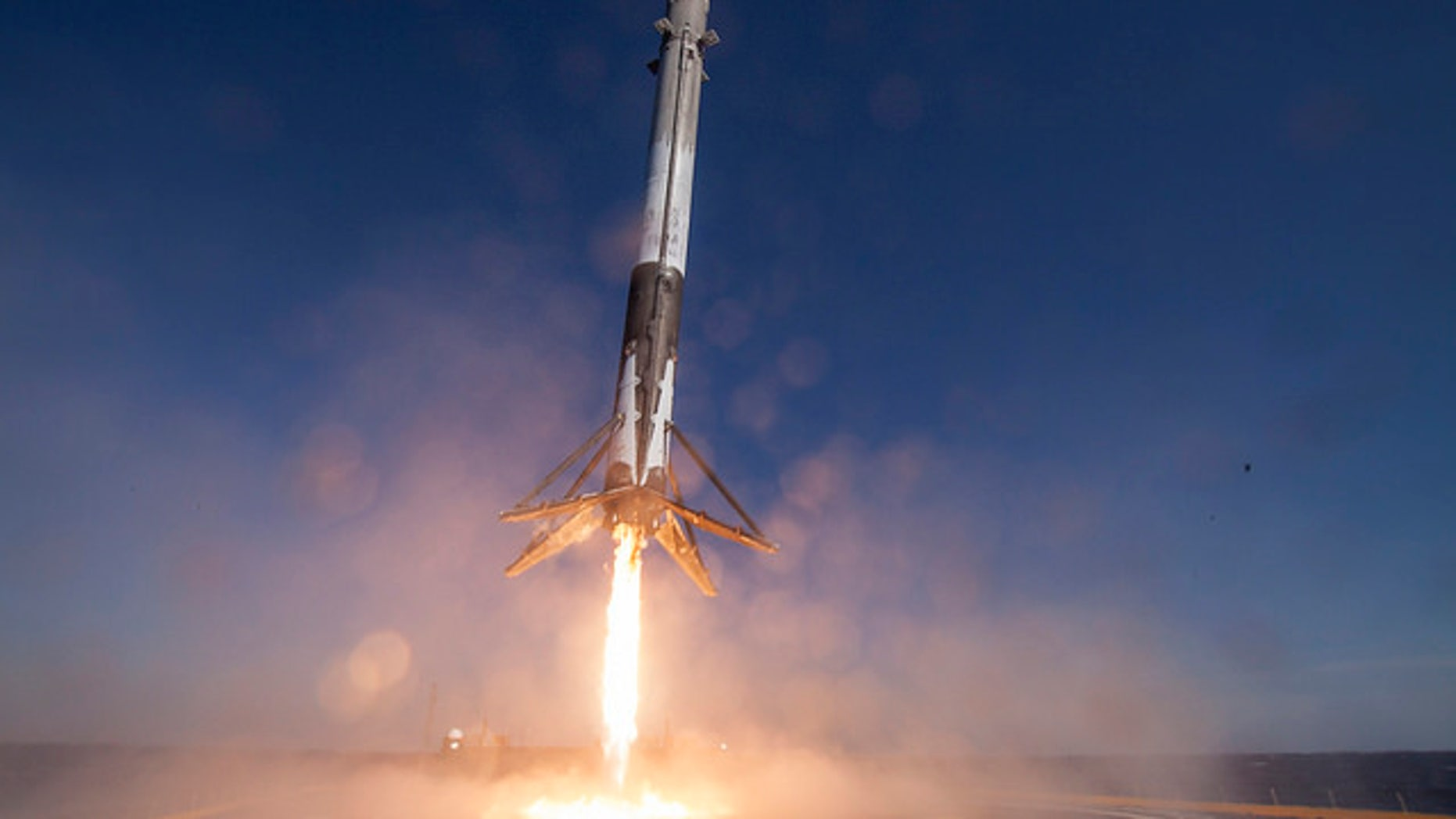 """The first stage of SpaceX's Falcon 9 rocket lands on the deck of the robotic ship """"Of Course I Still Love You"""" on April 8, 2016 (Credit: SpaceX)"""