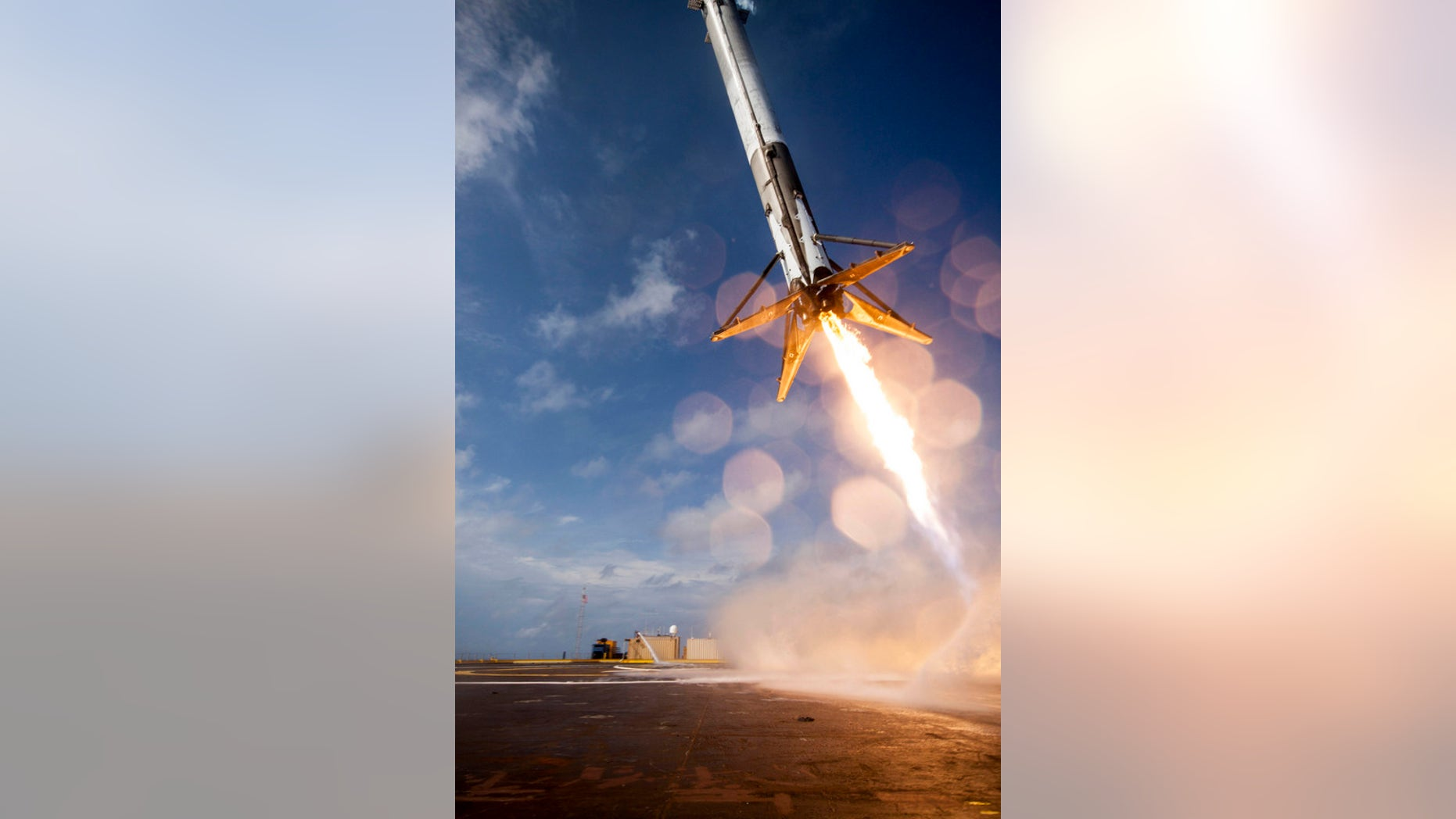 """The first stage of SpaceX's Falcon 9 rocket attempts to land on the deck of a """"drone ship"""" after sending the company's Dragon cargo capsule toward the International Space Station on April 14, 2015."""