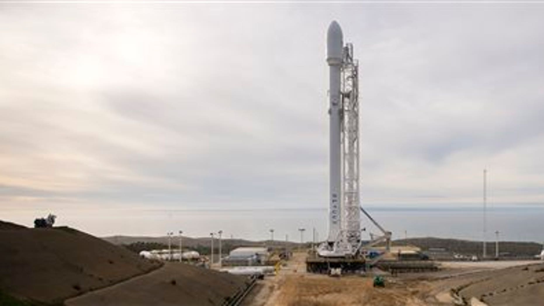 The SpaceX Falcon 9 rocket is seen at Vandenberg Air Force Base Space Launch Complex 4 East with the Jason-3 spacecraft onboard, Saturday, Jan. 16, 2016, in California.  (Bill Ingalls/NASA via AP)