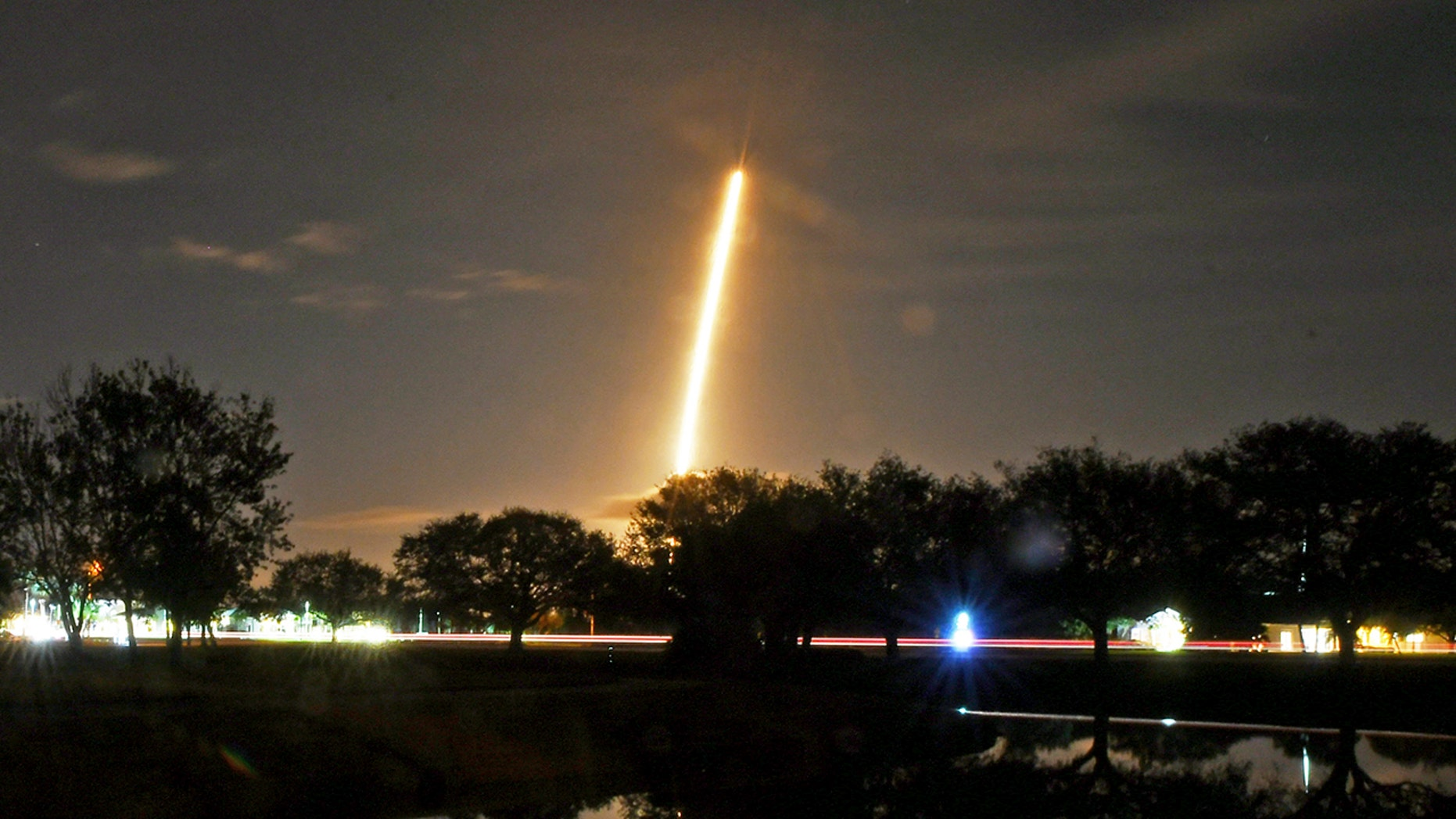 In this image made with a long exposure the SpaceX Falcon 9 rocket launches from Cape Canaveral Air Force Station.