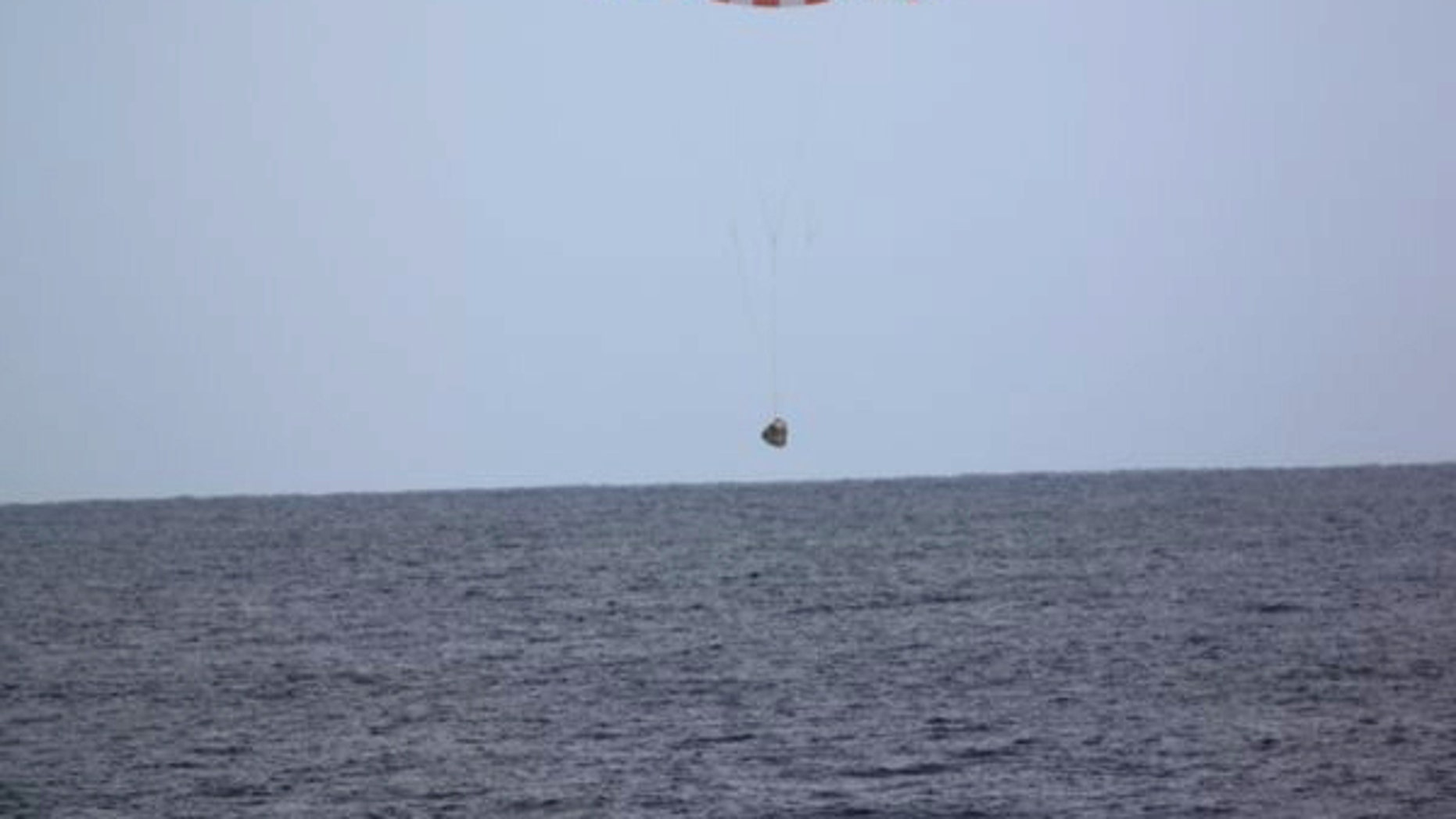 In this photo released by SpaceX, a SpaceX capsule containing science samples from NASA's one-year space station resident, approaches the Pacific Ocean, a few hundred miles off the Southern California coast, Wednesday, May 11, 2016. (SpaceX via AP)