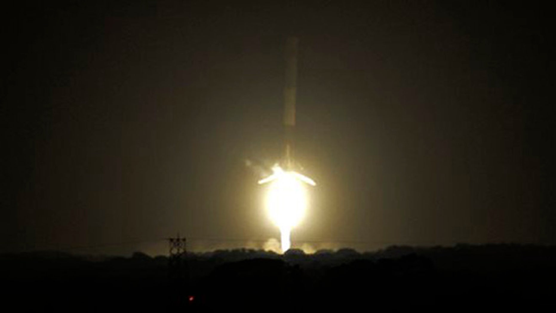 The SpaceX Falcon 9 rocket successfully lands at historic Complex 13 at Cape Canaveral Air Force Station, Monday, Dec. 21, 2015. The rocket, carrying 11 communications satellites for Orbcomm, Inc., is the first launch of the rocket since a failed mission to the International Space Station in June. (Craig Bailey/Florida Today via AP)