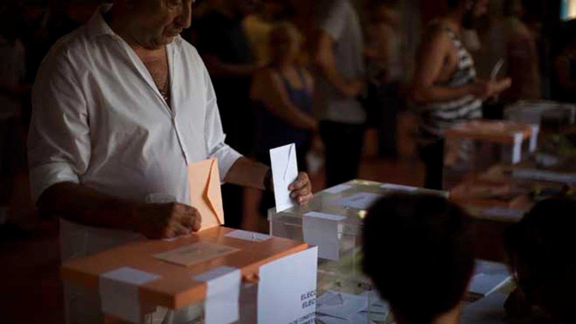 A man casts his vote for the national elections in Barcelona, Spain, Sunday. Spaniards voted Sunday in an unprecedented repeat election that aimed to break six months of political deadlock after a December ballot left the country without an elected government. (AP Photo/Emilio Morenatti)