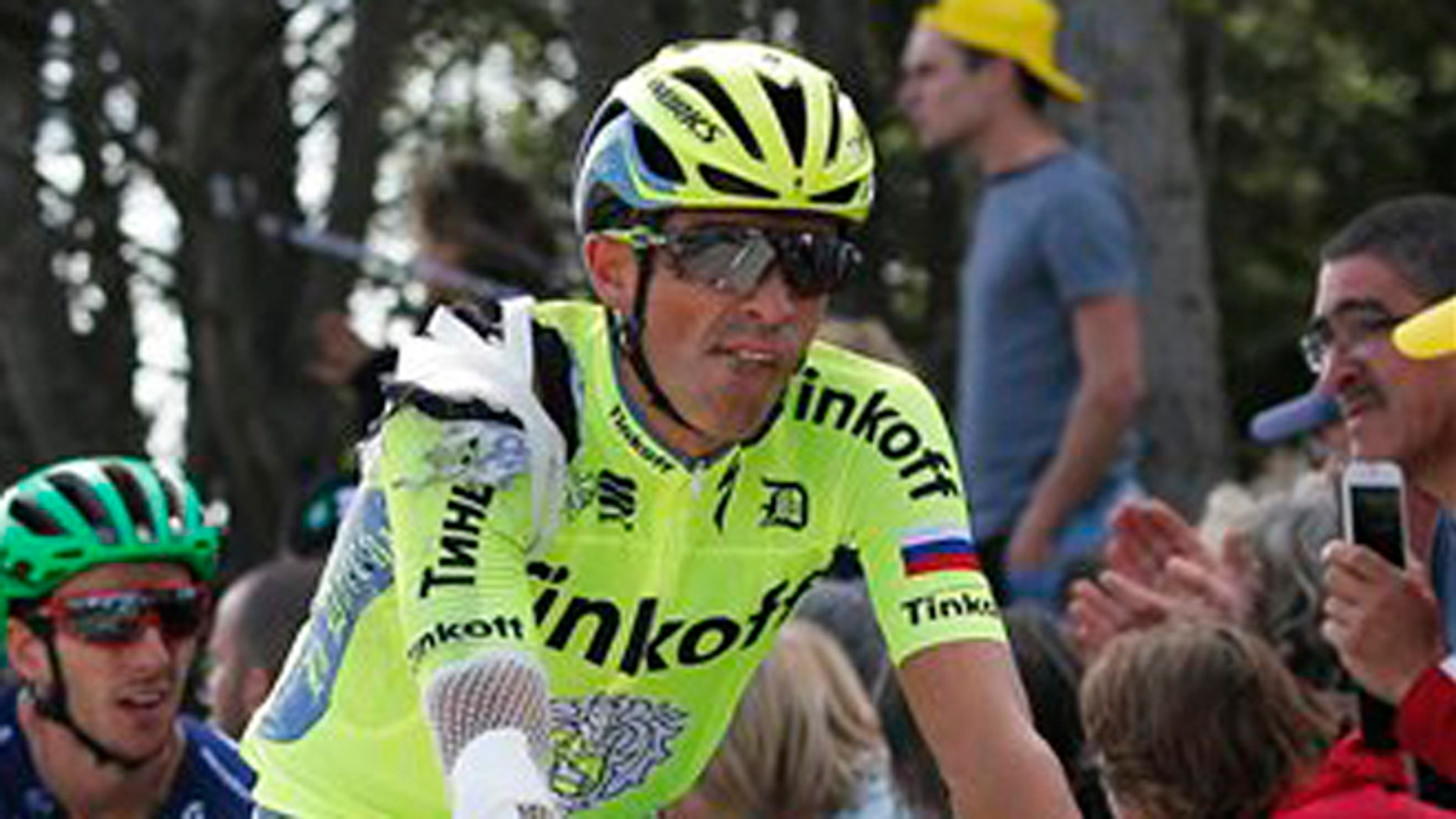 Spain's Alberto Contador crosses the finish line after crashing in the first stage of the Tour de France cycling race over 188 kilometers (116.8 miles) with start in Mont-Saint-Michel and finish in Utah Beach, France, Saturday, July 2, 2016. (AP Photo/Christophe Ena)