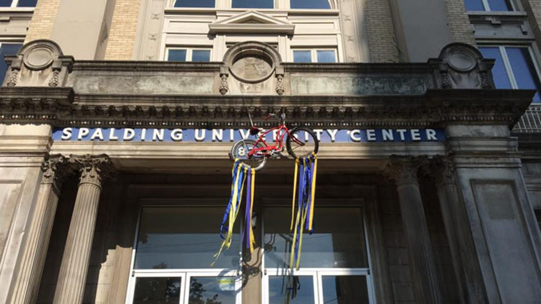 Spalding University hung a red bicycle from school's University Center to commemorate Muhammad Ali. (Spalding University)