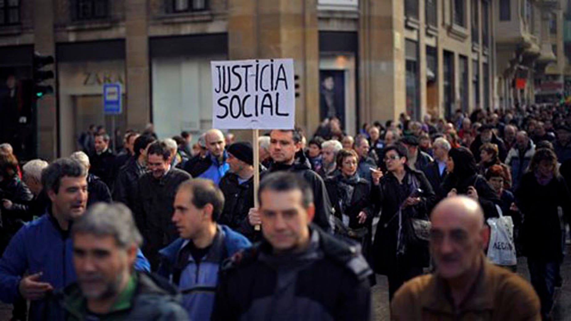 Jan. 21, 2012: A man holds a poster claiming Social Justice during a march to protest against the cuts planned by the conservative Popular Party of Spanish Prime Minister Mariano Rajoy, in Pamplona, northern Spain. The country suffers a strong economic crisis with more than five million unemployed.