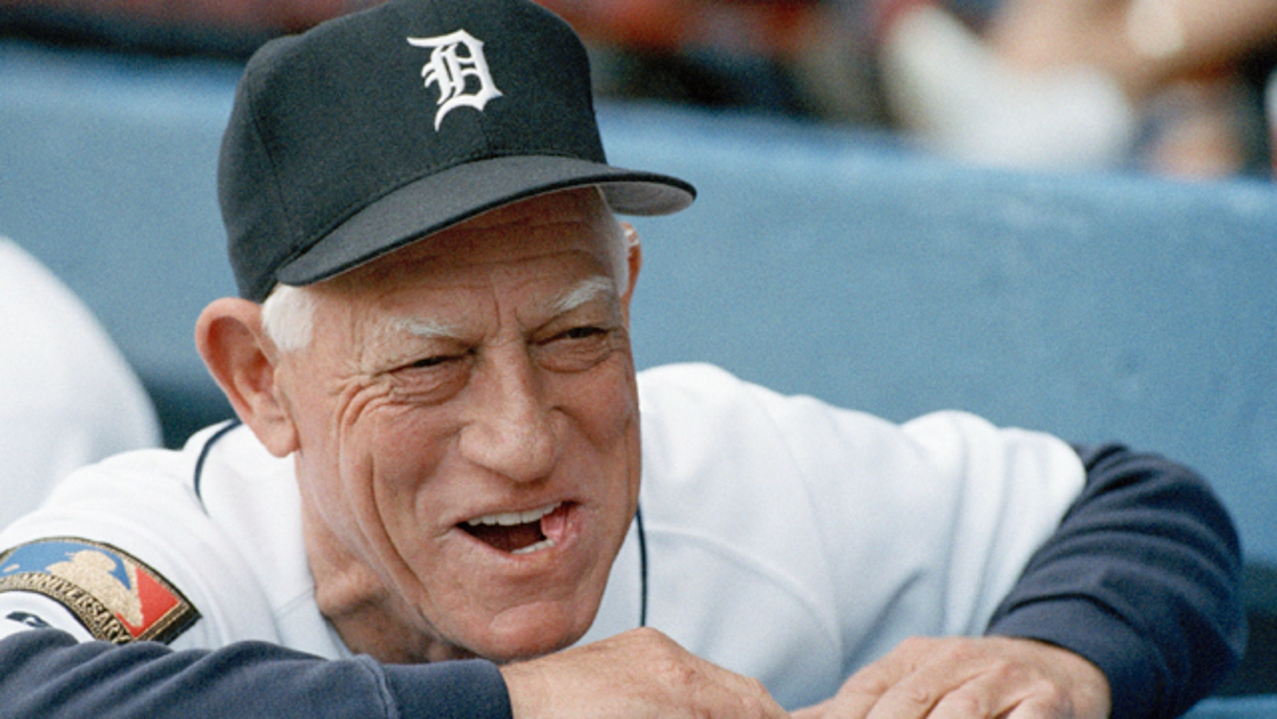 July 26, 1994:  Detroit Tigers manager Sparky Anderson smiling as he looks out from the dugout prior to the start of a baseball game against the Seattle Mariners in Detroit.